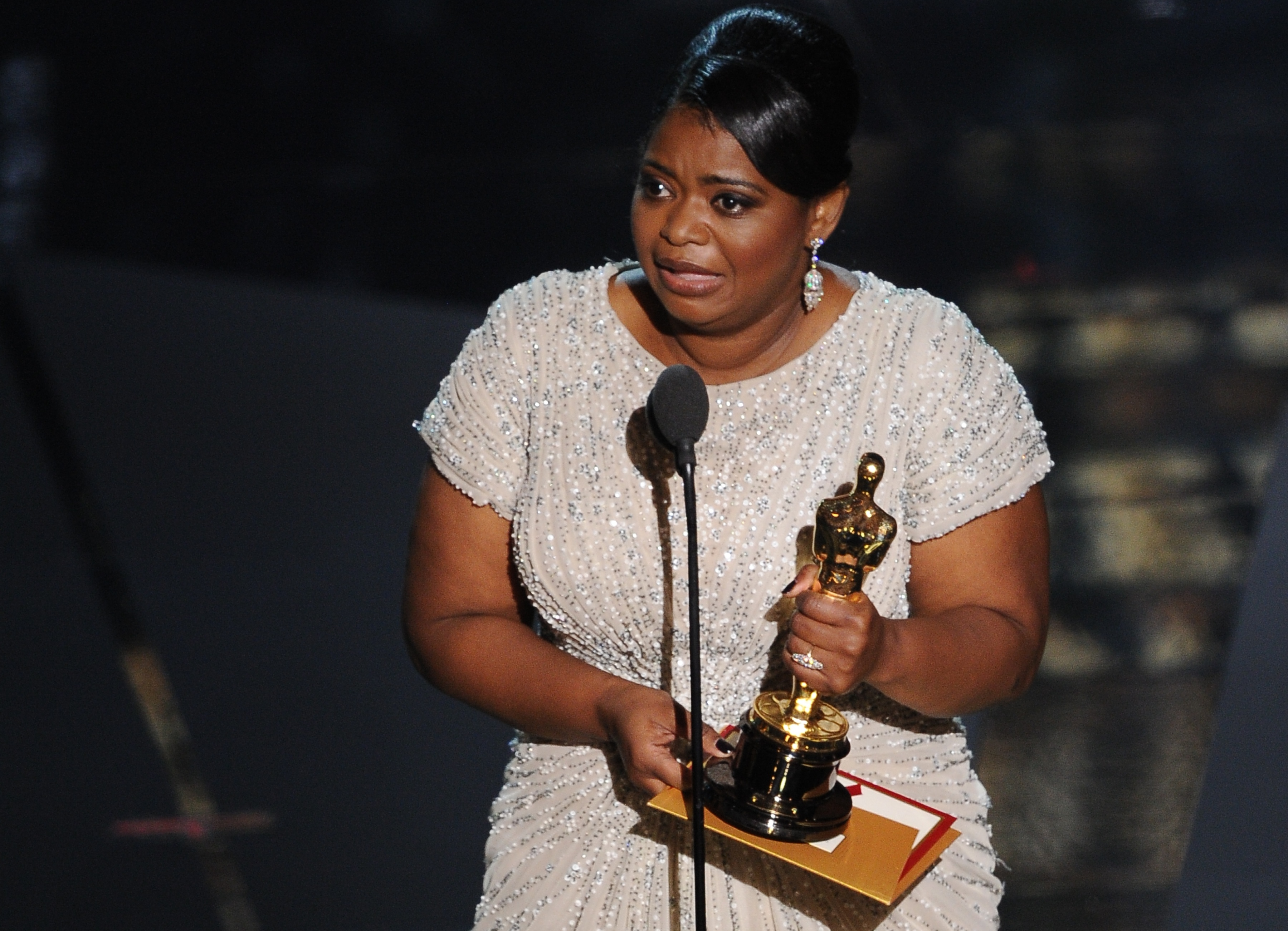 The winner for Best Supporting Actress O