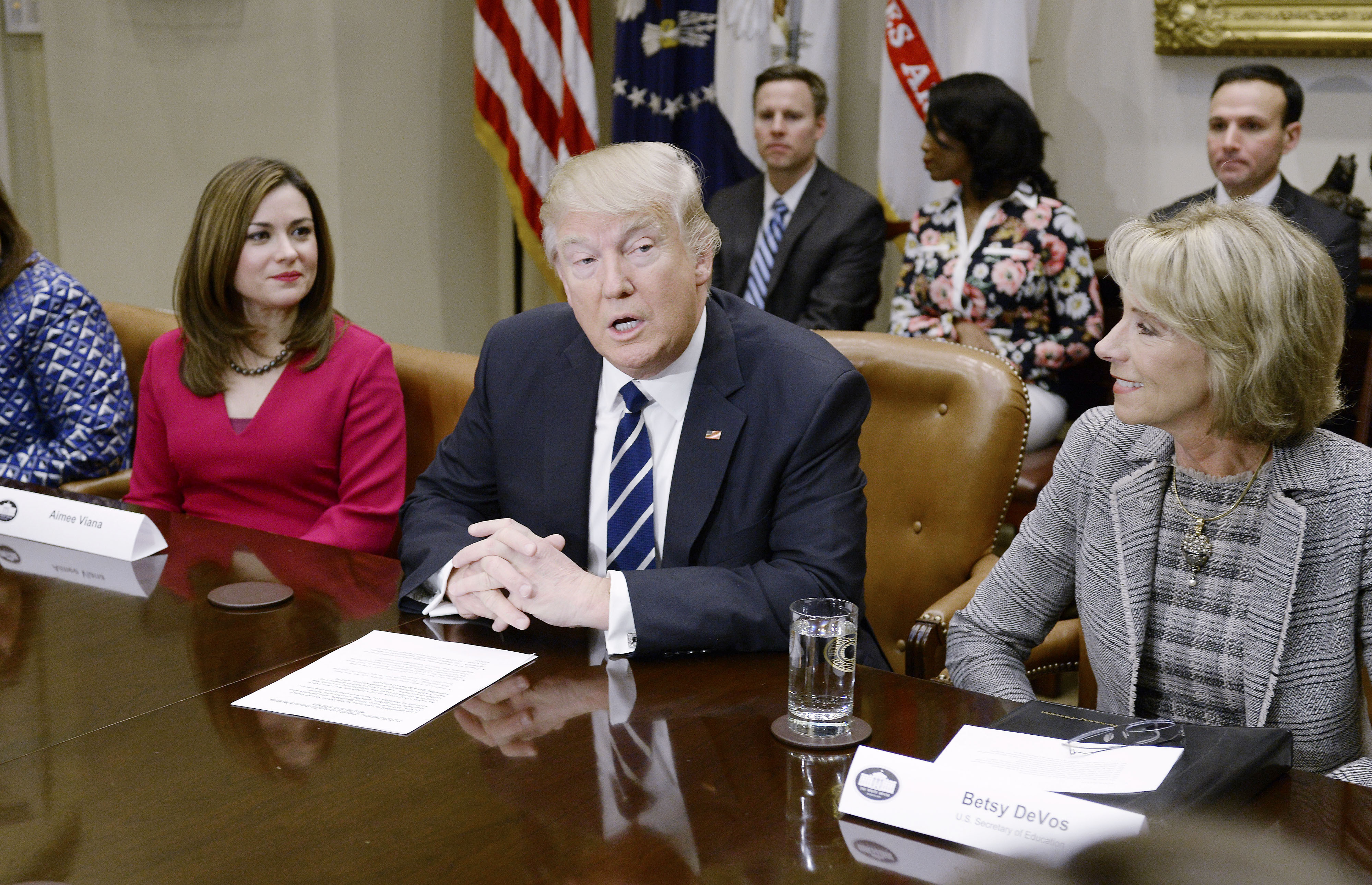 Donald Trump participates in a parent-teacher conference listenin