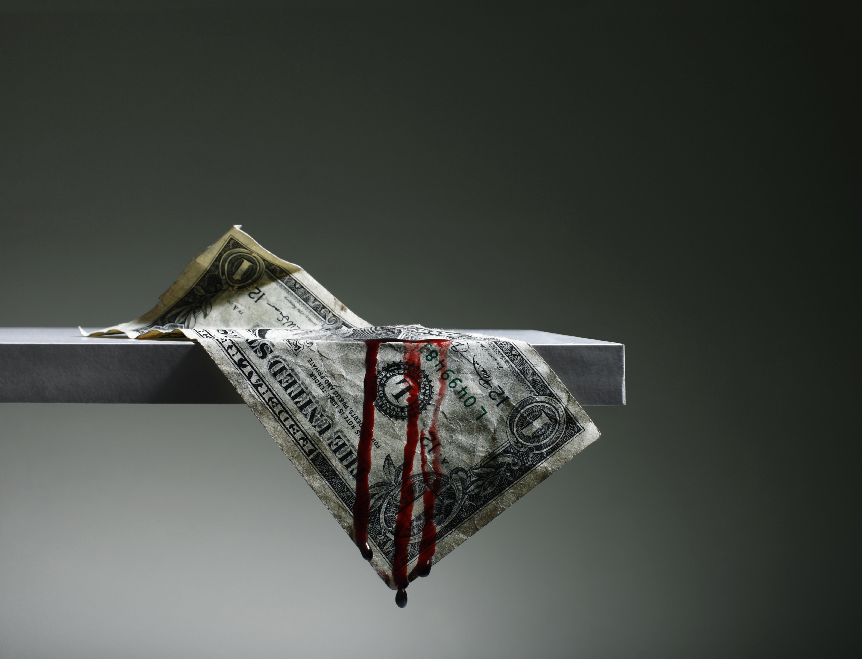 US Dollar hanging from Shelf Bleeding