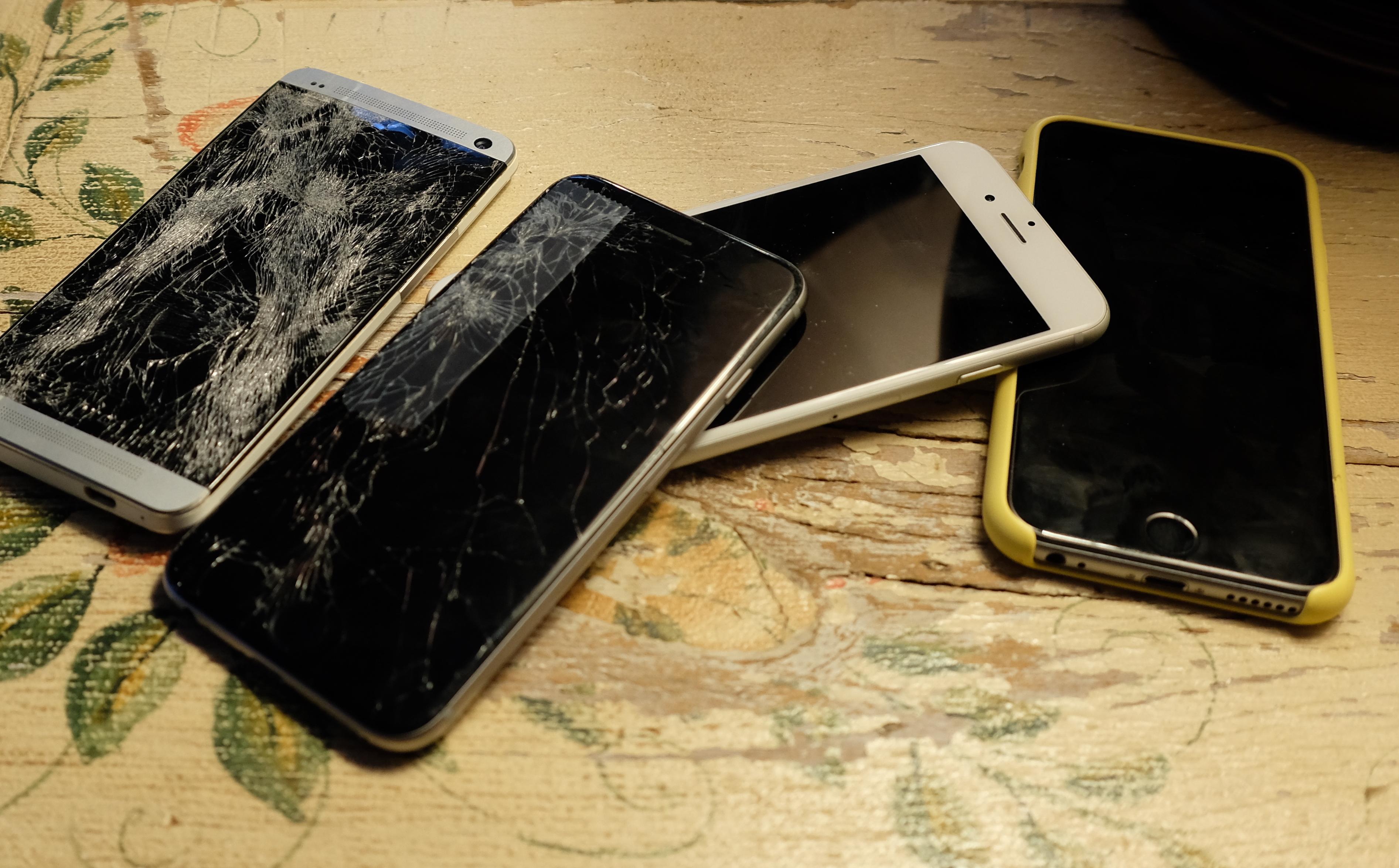 Pile of broken smartphones