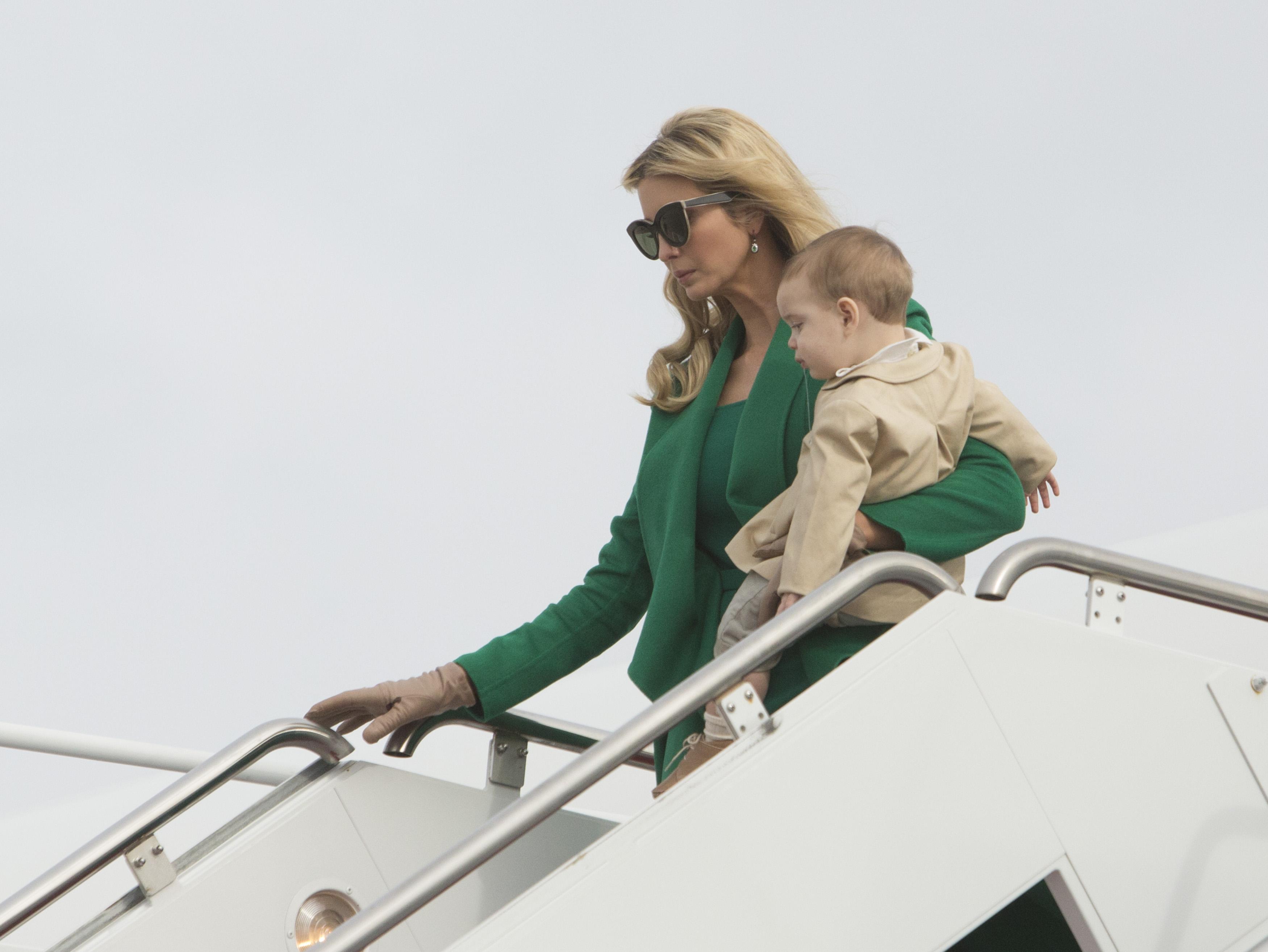 Ivanka Trump, carrying her son, Theodore James Kushner