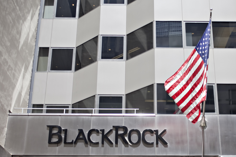 A U.S. flag flies outside the headquarters of BlackRock Inc.