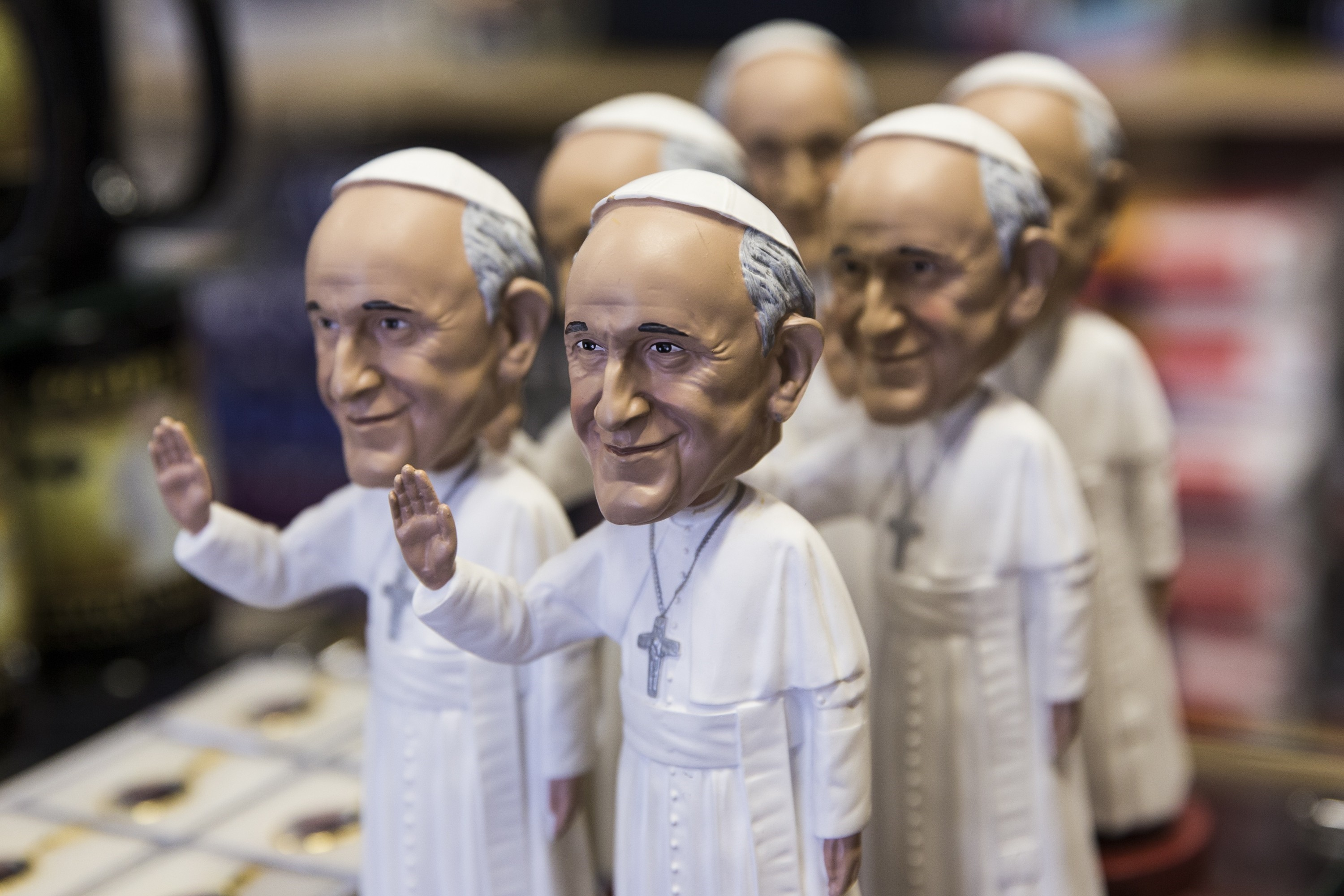 A Pope bobblehead is one of many Pope Francis themed souvenirs for sale at White House Gifts before the Popes first official visit to the United States in Washington, USA on September 21, 2015.