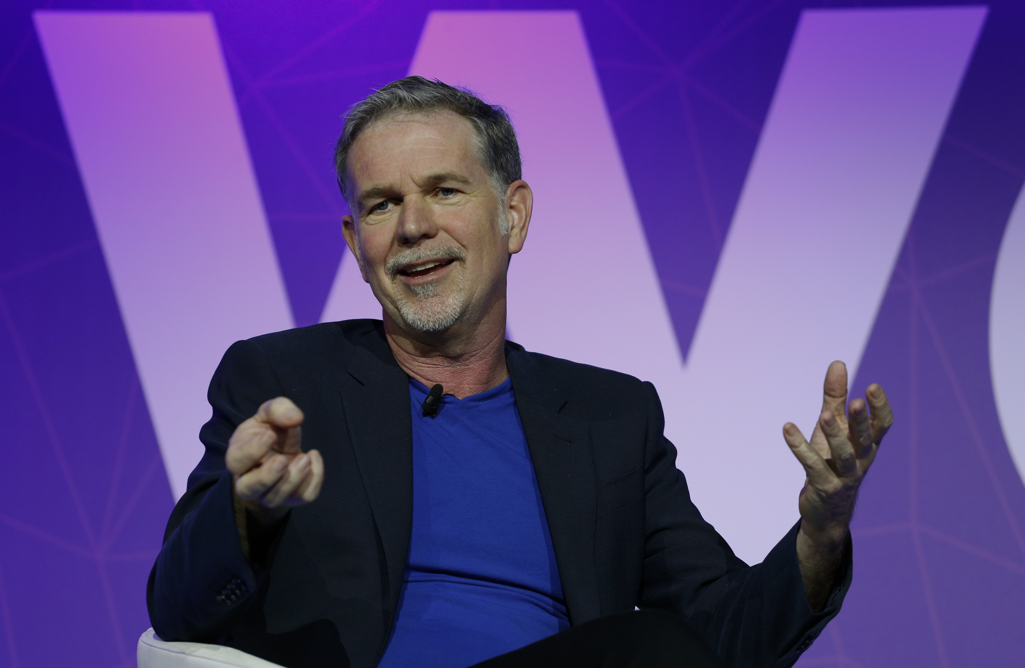 Netflix's CEO Hastings gestures as he delivers his keynote speech during Mobile World Congress in Barcelona