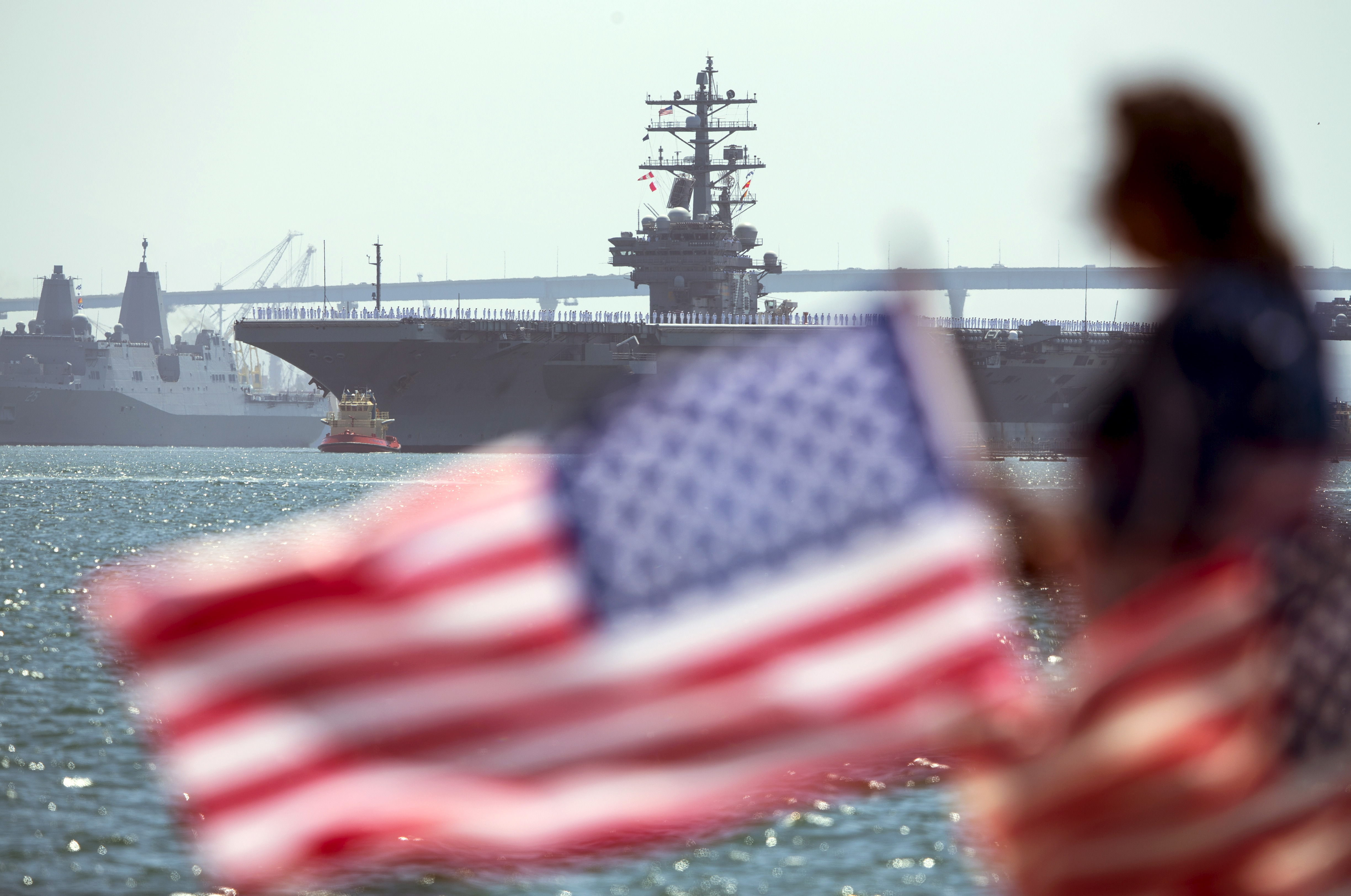 The USS Ronald Reagan is followed by USS Somerset as it departs for Yokosuka, Japan from Naval Station North Island in San Diego