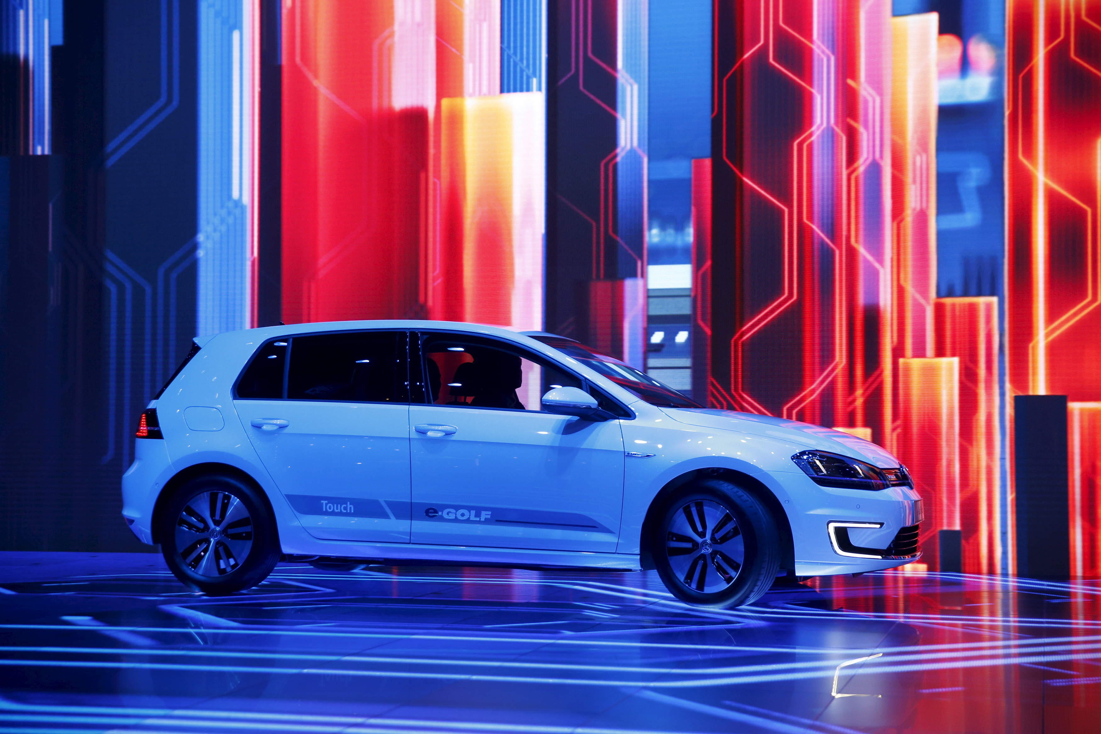 The Volkswagen e-Golf Touch electric vehicle is driven onstage during Herbert Diess' keynote address at the 2016 CES trade show in Las Vegas