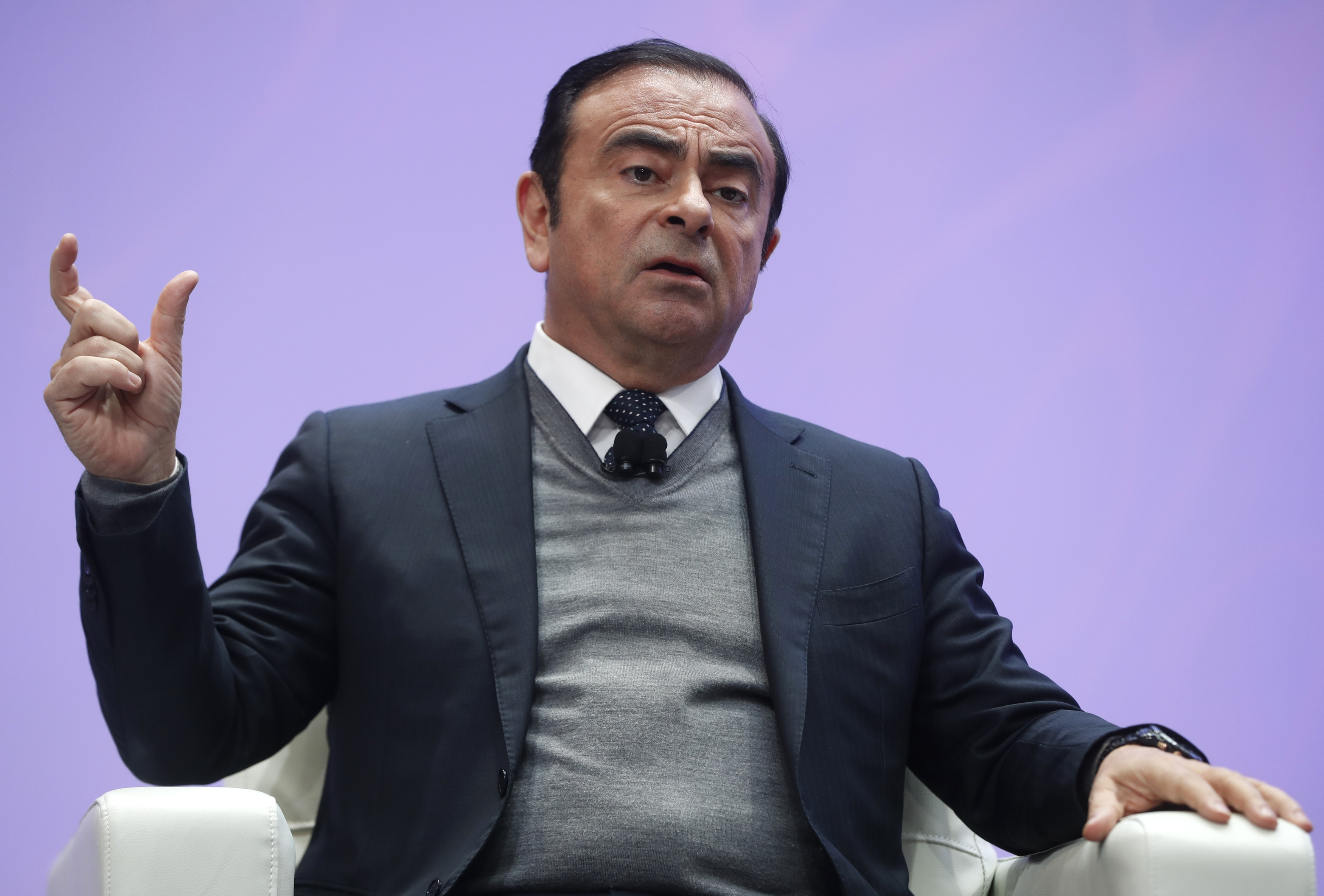 Chairman and CEO of Nissan Motor Corporation Ghosn speaks during the North American International Auto Show in Detroit