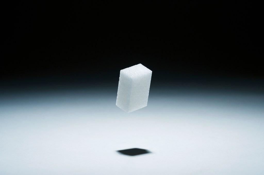 A cube of sugar in mid-air