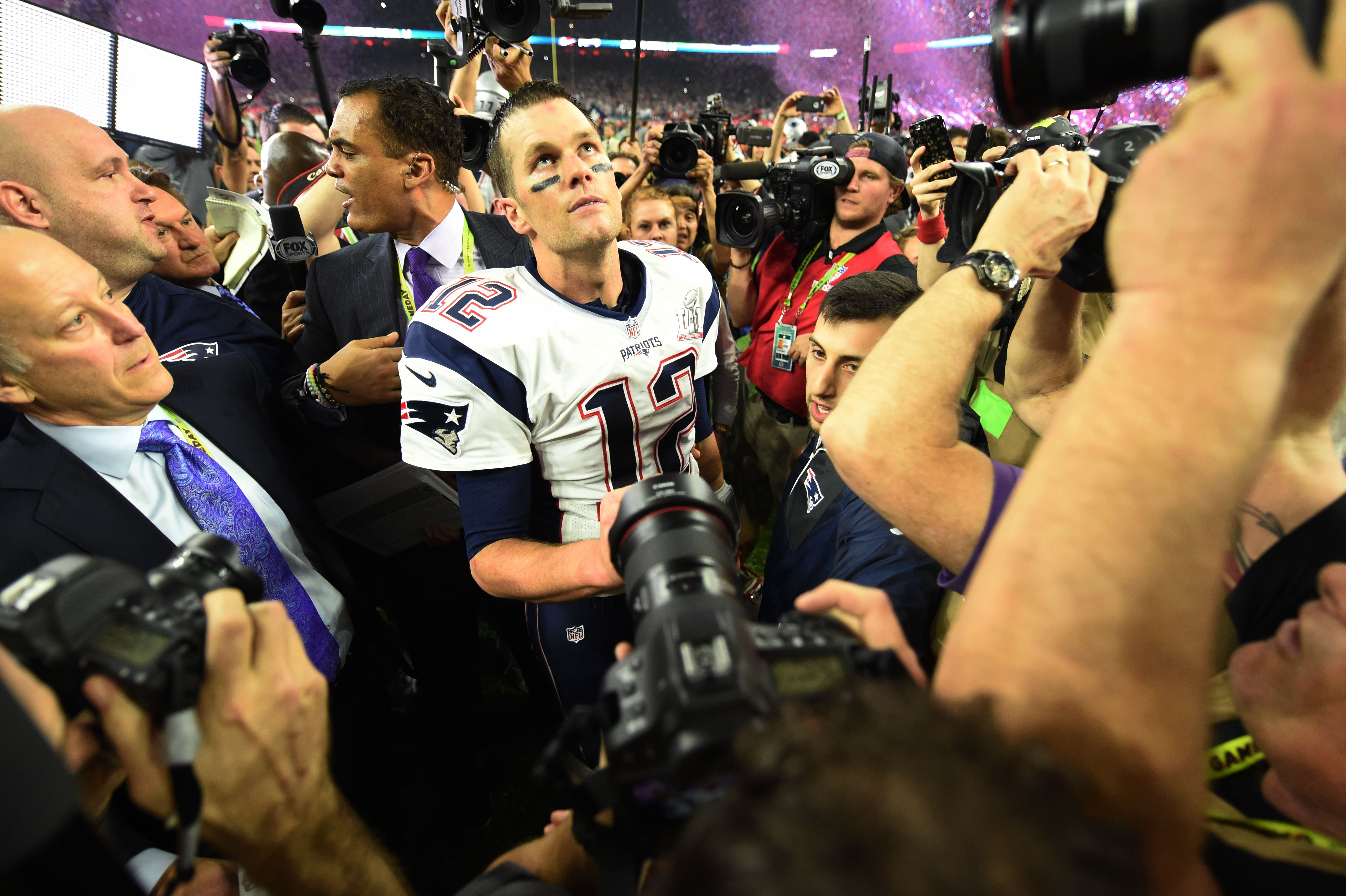 Tom Brady #12 of the New England Patriots looks on after defeating the Atlanta Falcons during Super Bowl 51 at NRG Stadium on February 5, 2017 in Houston, Texas.