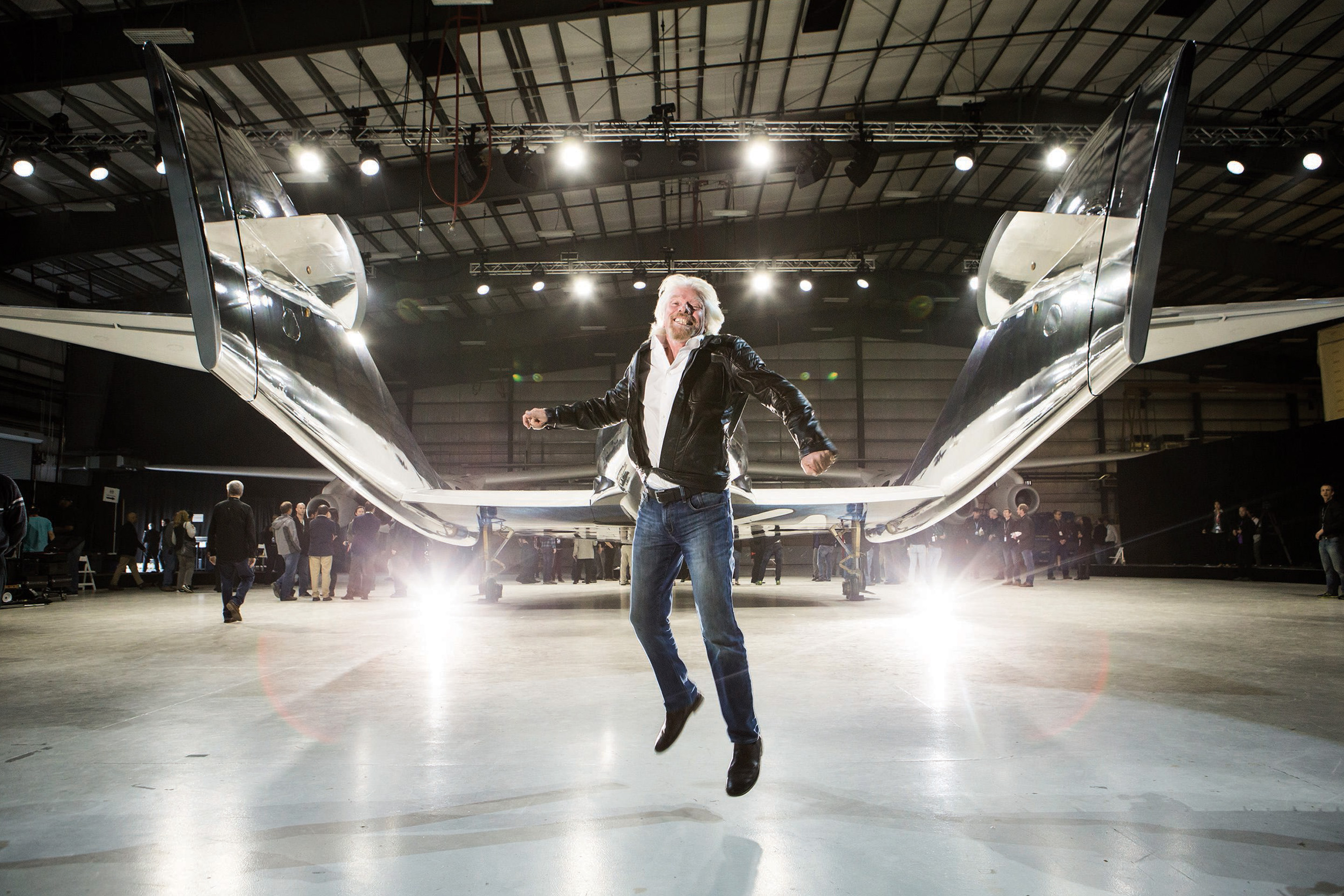 Richard Branson celebrates after unveiling Virgin Galactic's  Spaceship Unity in February  2016.