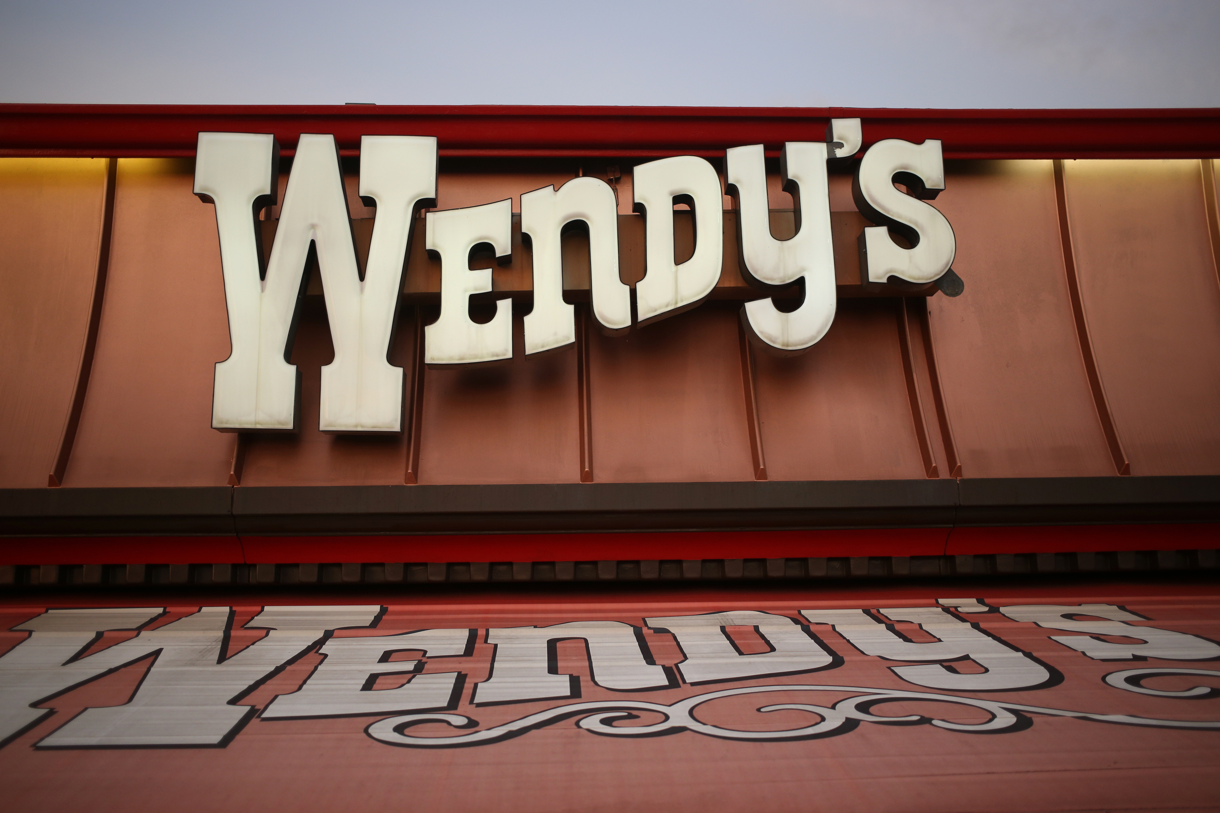 Signage is displayed outside a Wendy's Co. restaurant in Mt. Vernon, Illinois, U.S., on Wednesday, July 29, 2015.