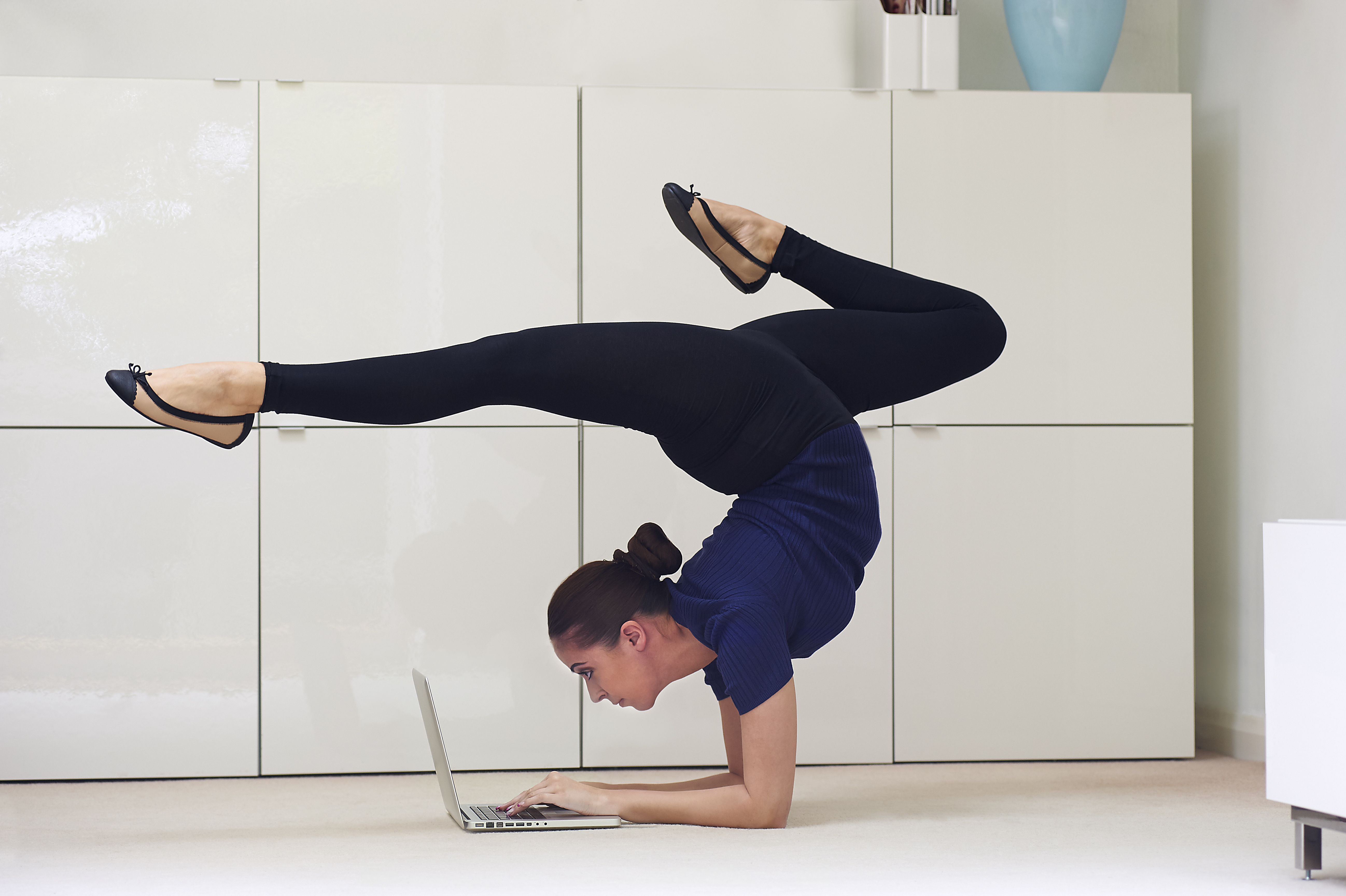 Contortionist using laptop computer