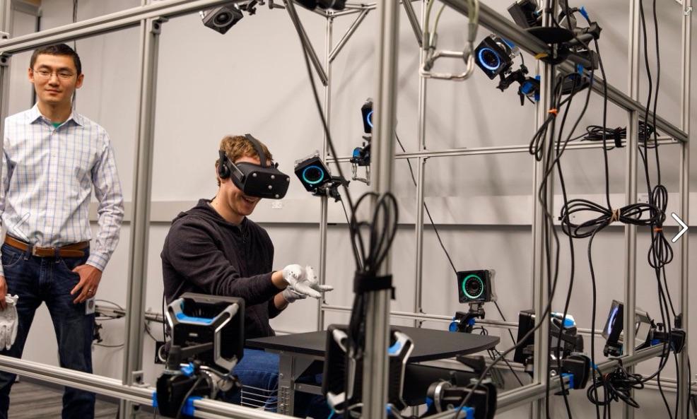 Facebook CEO Mark Zuckerberg tries out VR glove.