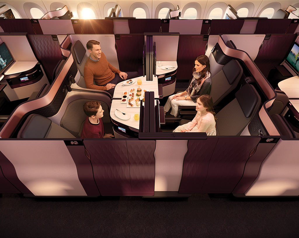 In the newest business class configuration rolled out by Qatar Airways, two pairs of adjacent seats can be turned into a double bed or meeting room for four.