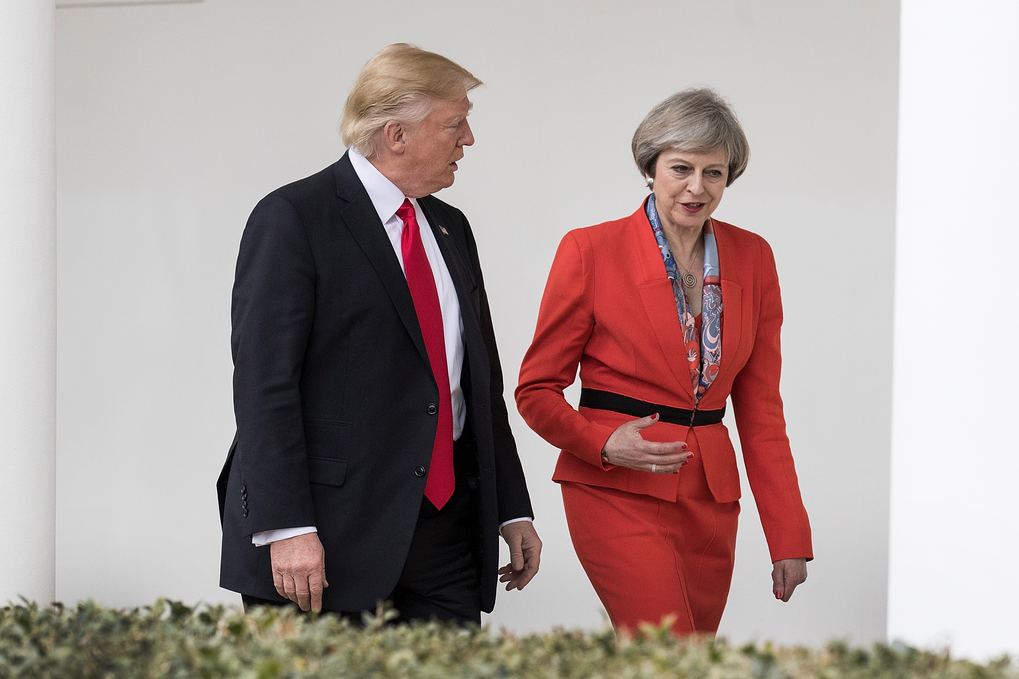 British Prime Minister Theresa May and U.S. President Donald Trump walk along The Colonnade of the West Wing at The White House on January 27, 2017 in Washington, DC.