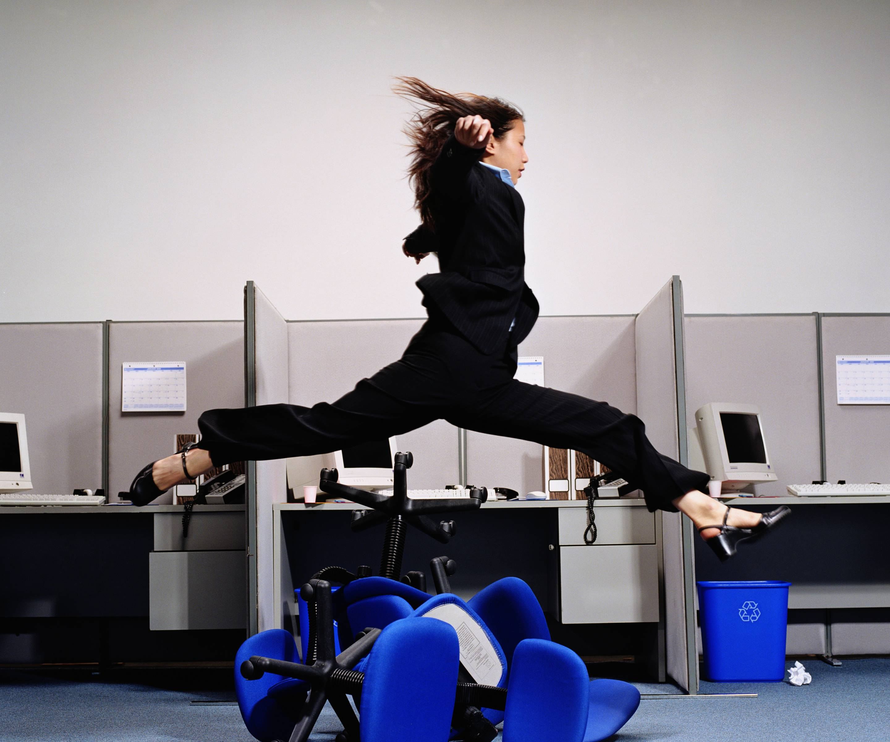 Successful businesswoman leaping to success