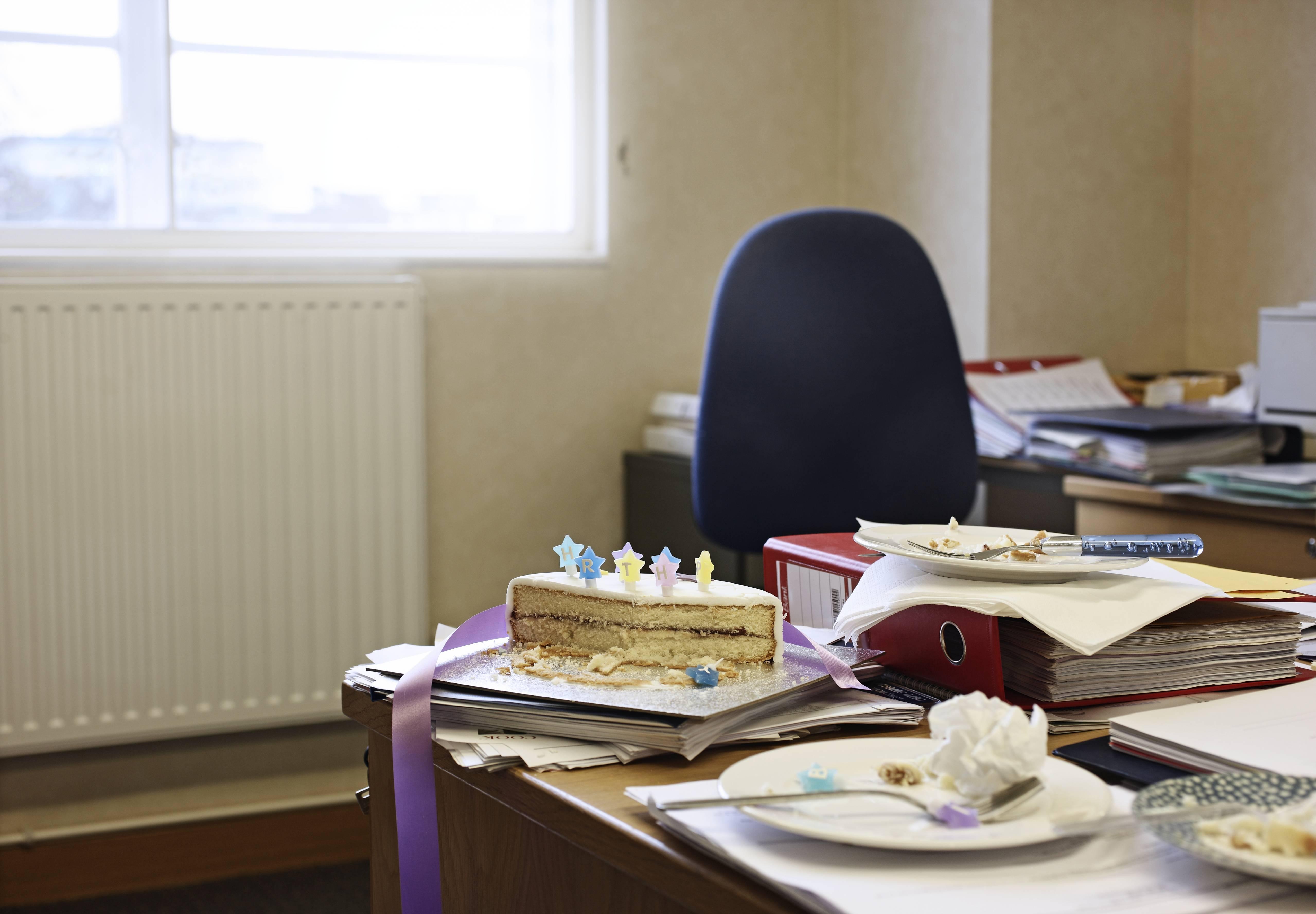 birthday cake on desk in office