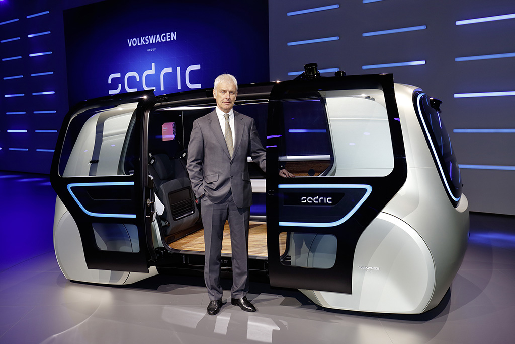 Volkswagen Group CEO Mattias Müller with the Sedric autonomous concept vehicle.