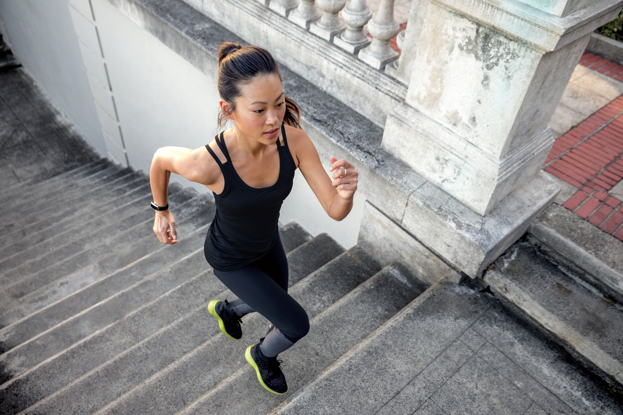 Runner wearing Fitbit Alta HR fitness tracker.