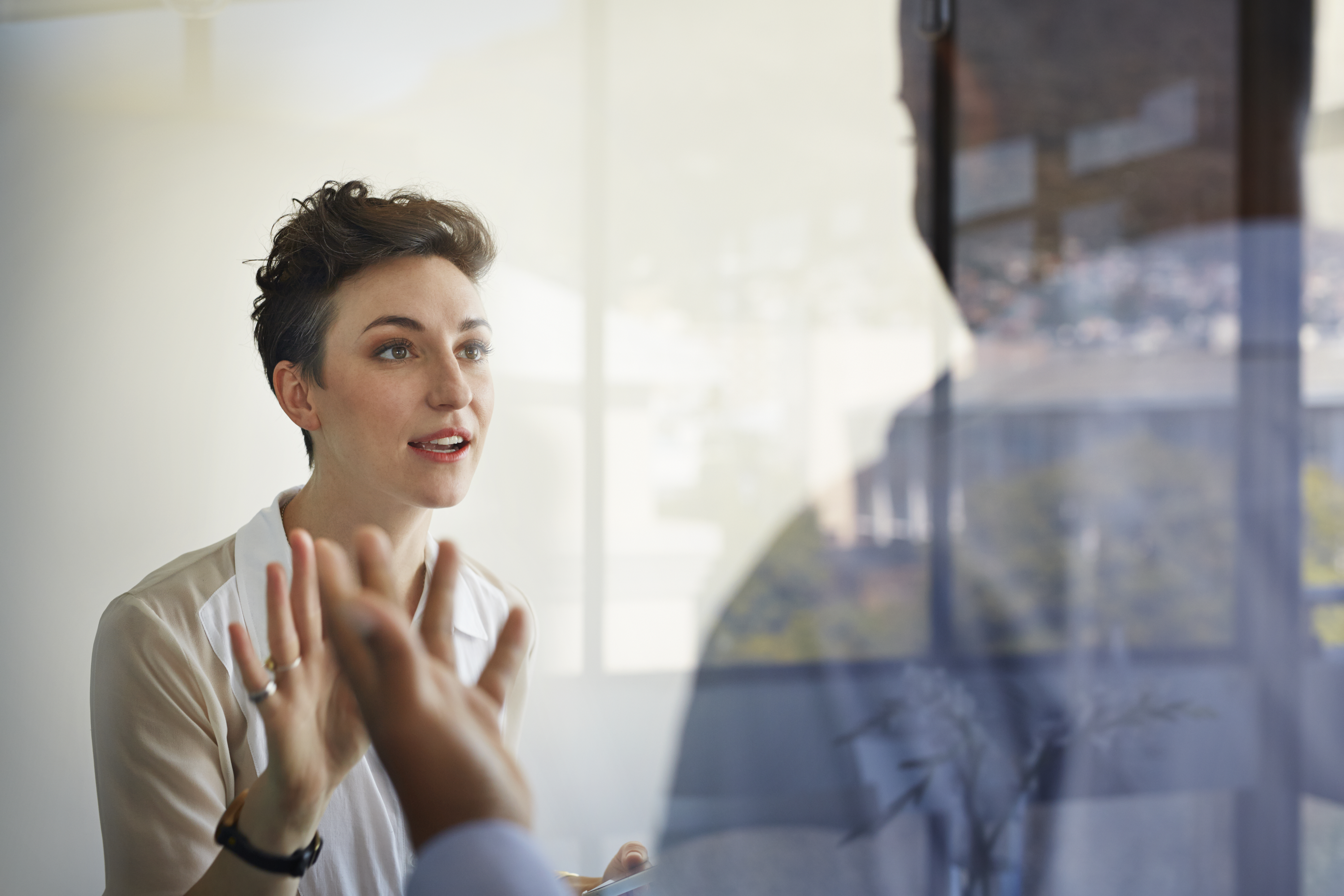 Businesswoman having discussion with male colleague
