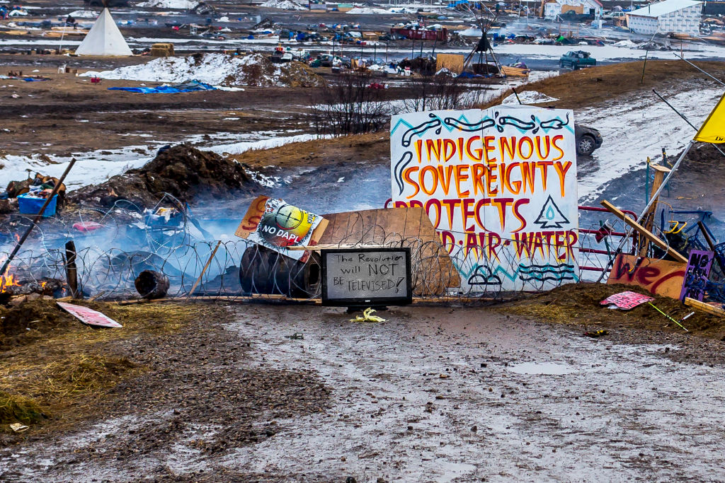 Defiant Dakota Access Pipeline water protectors faced-off