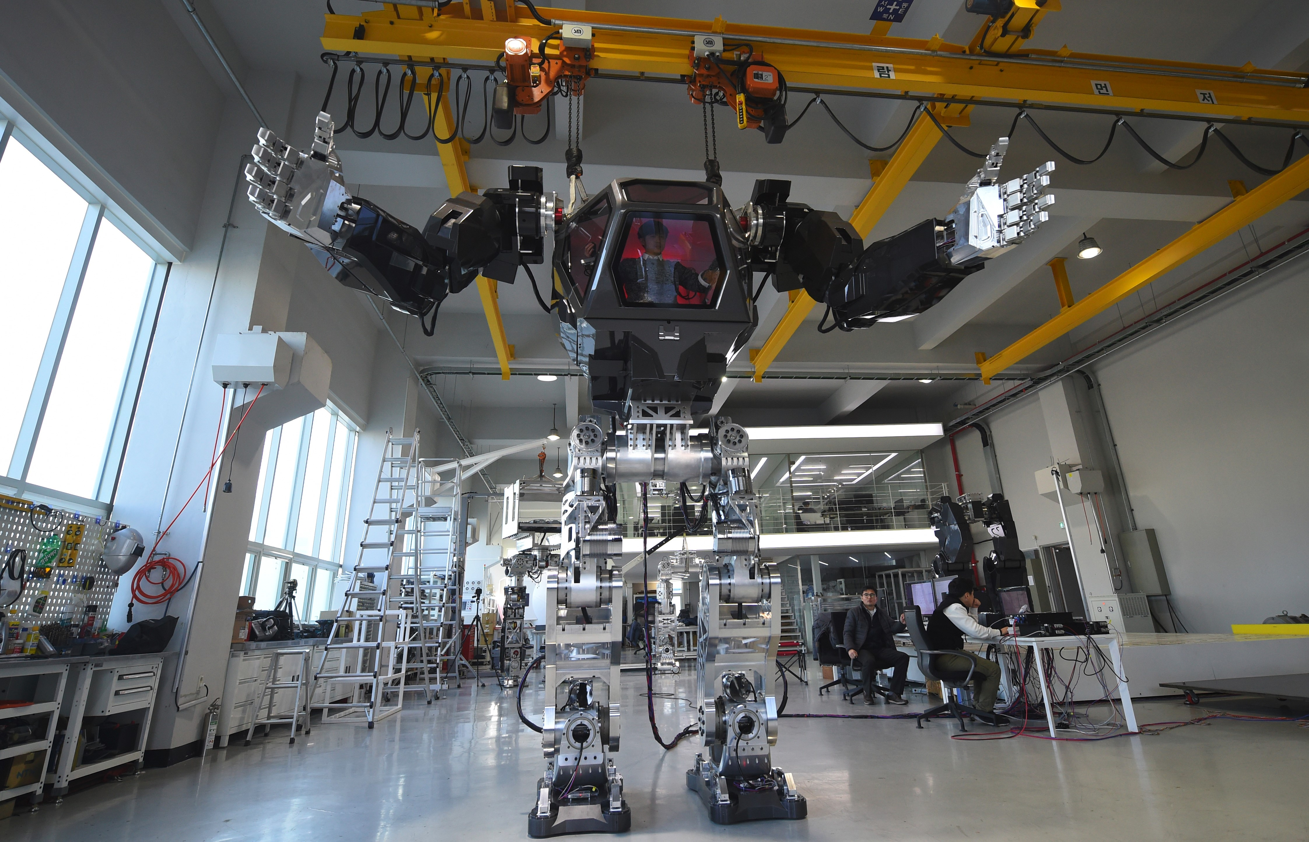 Engineers test a humanoid-manned robot dubbed Method-2 in a lab of the Hankook Mirae Technology in Gunpo, south of Seoul, on December 27, 2016.