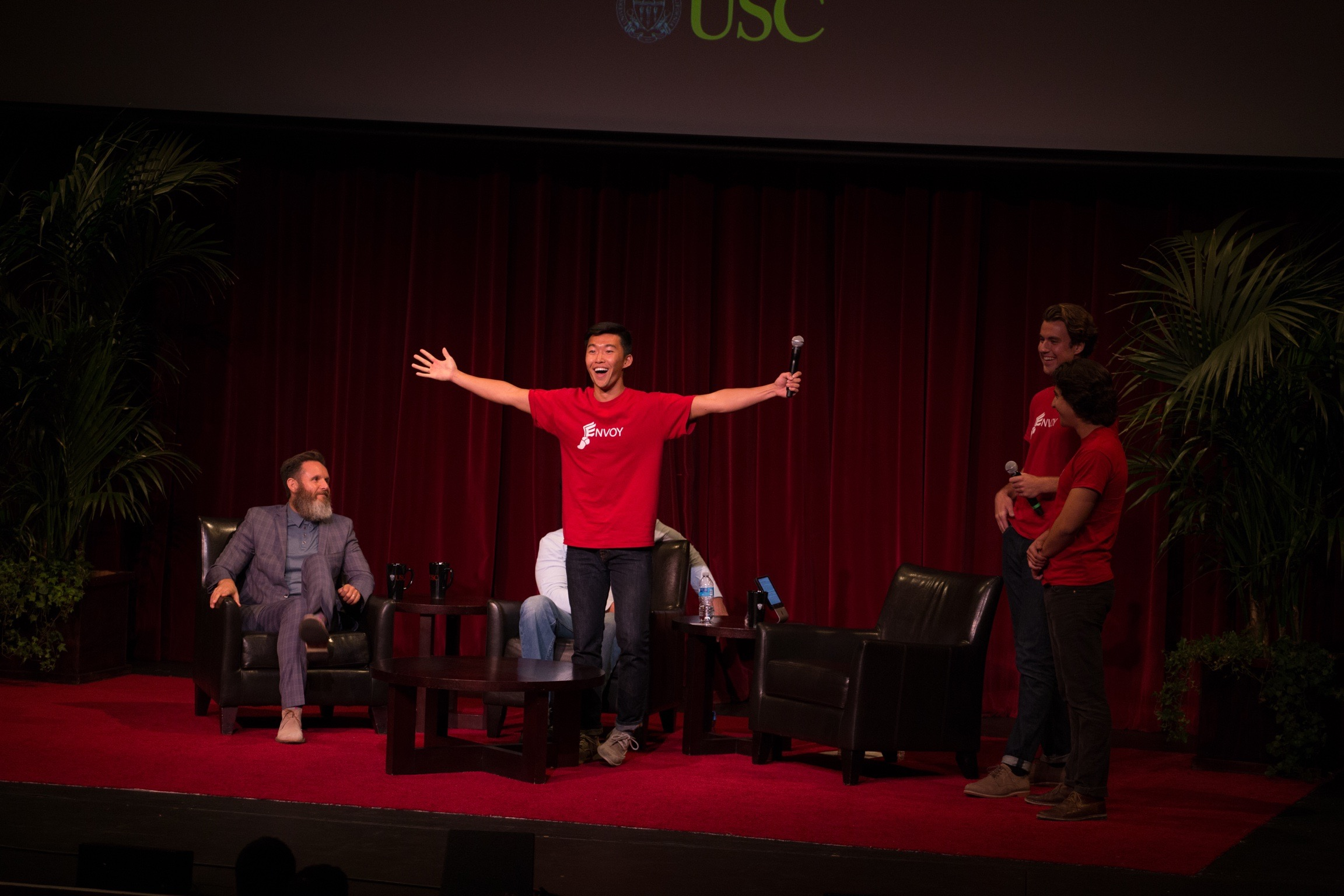 EnvoyNow founder Anthony Zhang on stage at a Shark Tank event on campus.