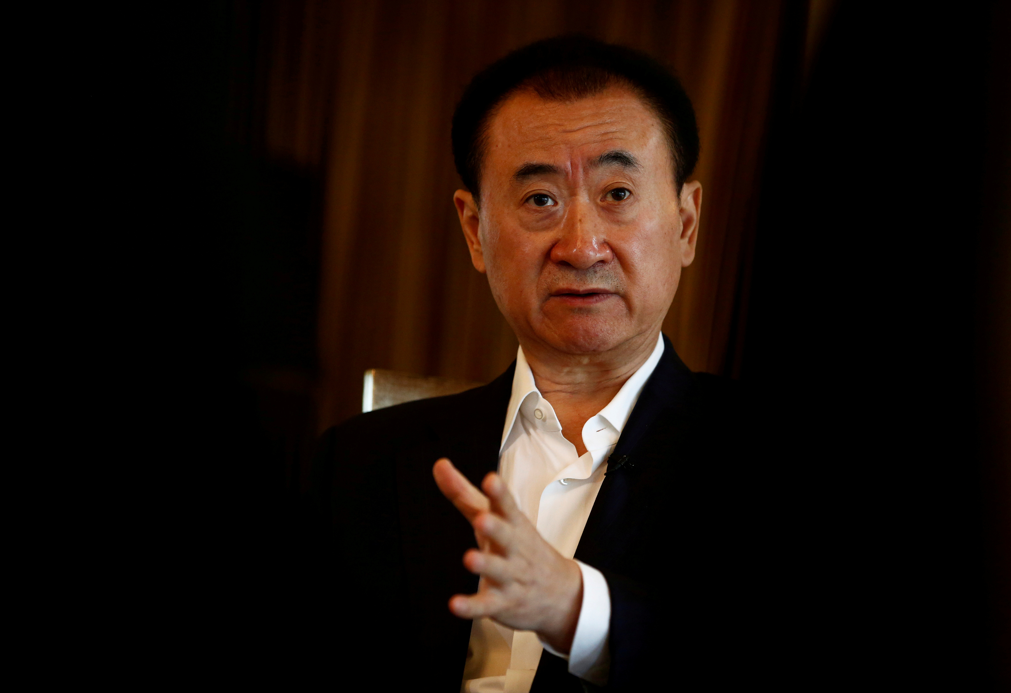 Wang Jianlin, chairman of the Wanda Group, speaks during an interview in Beijing