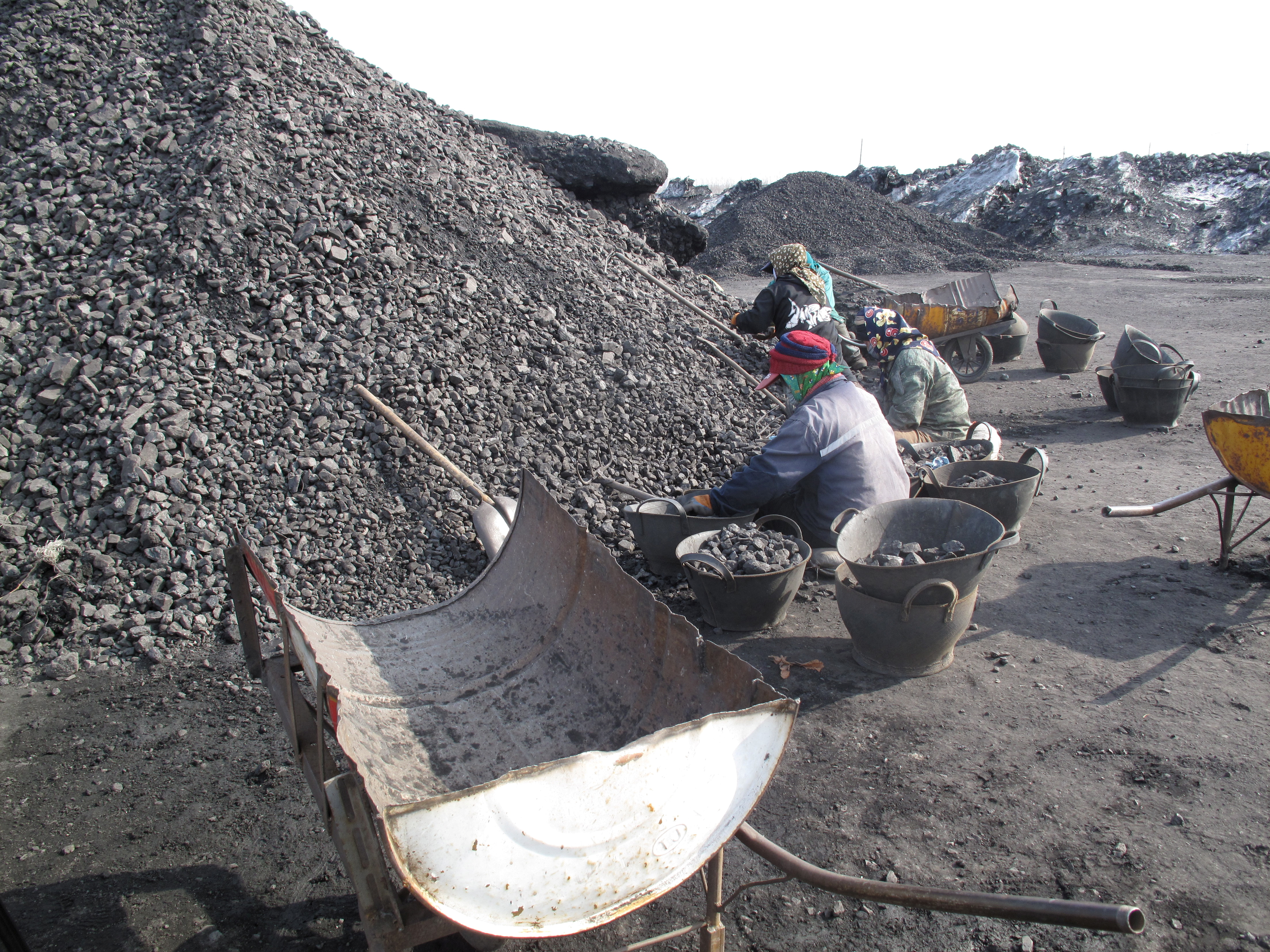 Workers are seen at Shuangyashan Mine, owned by Longmay Group, in Shuangyashan