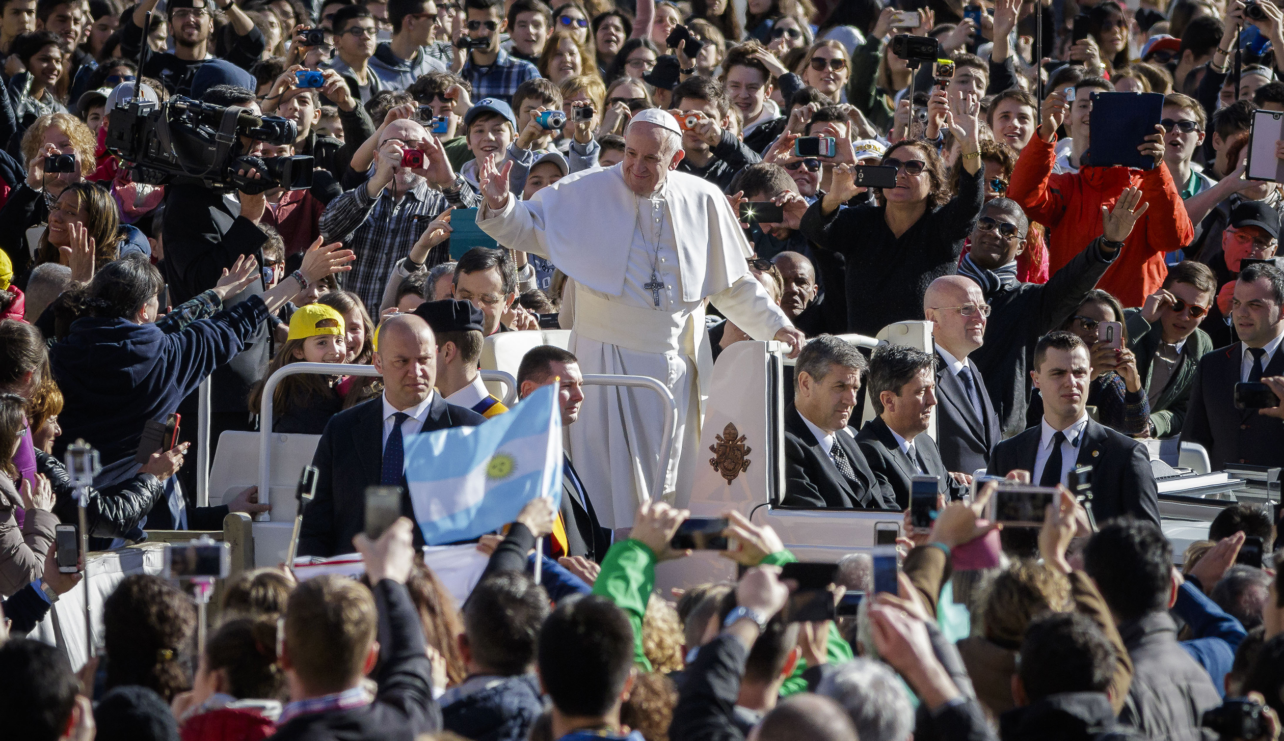 Pope Francis rides on the Popemobile through the crowd of