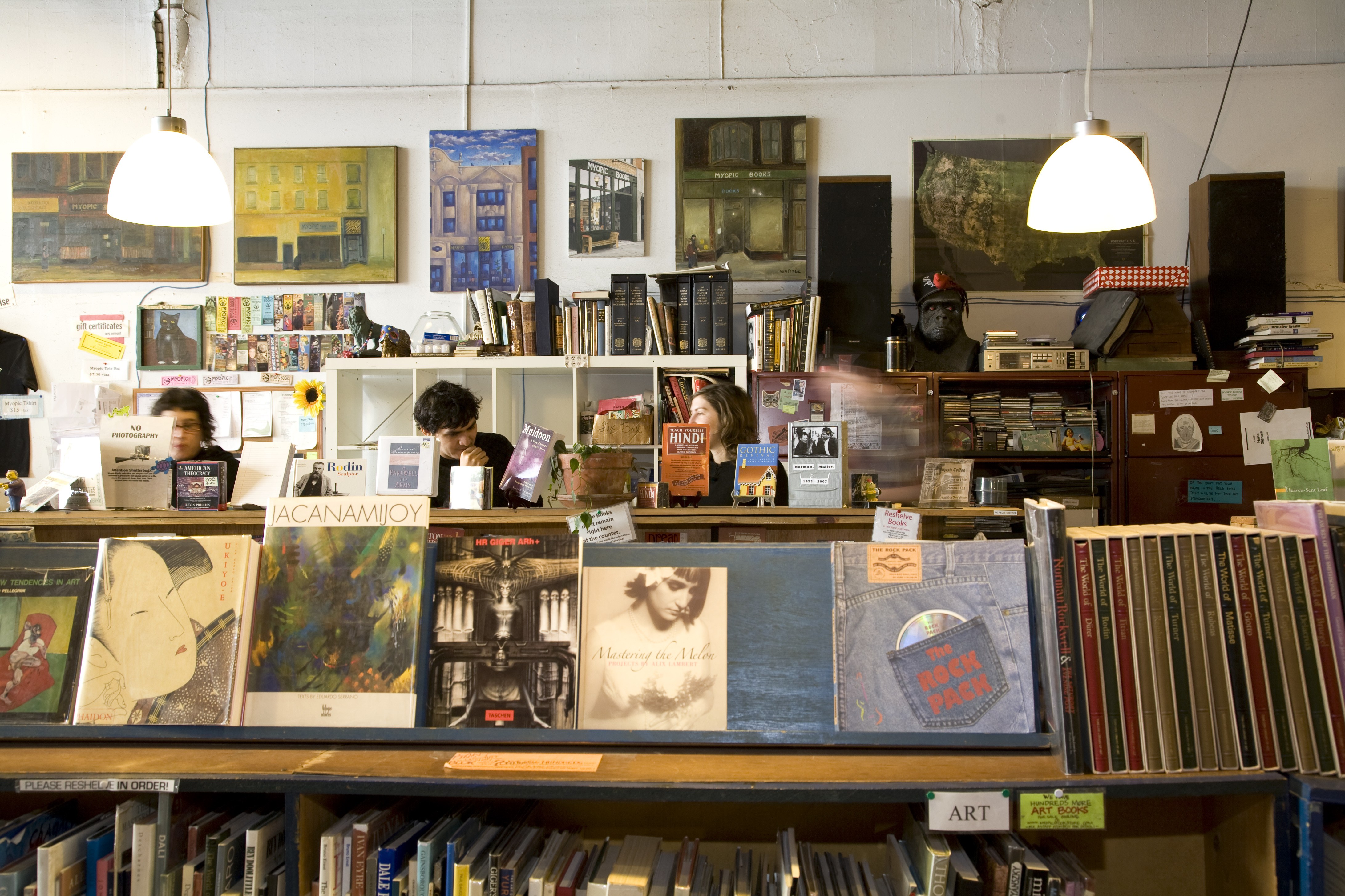 Books for sale at Myopic Books, with employees behind counter, Wicker Park.