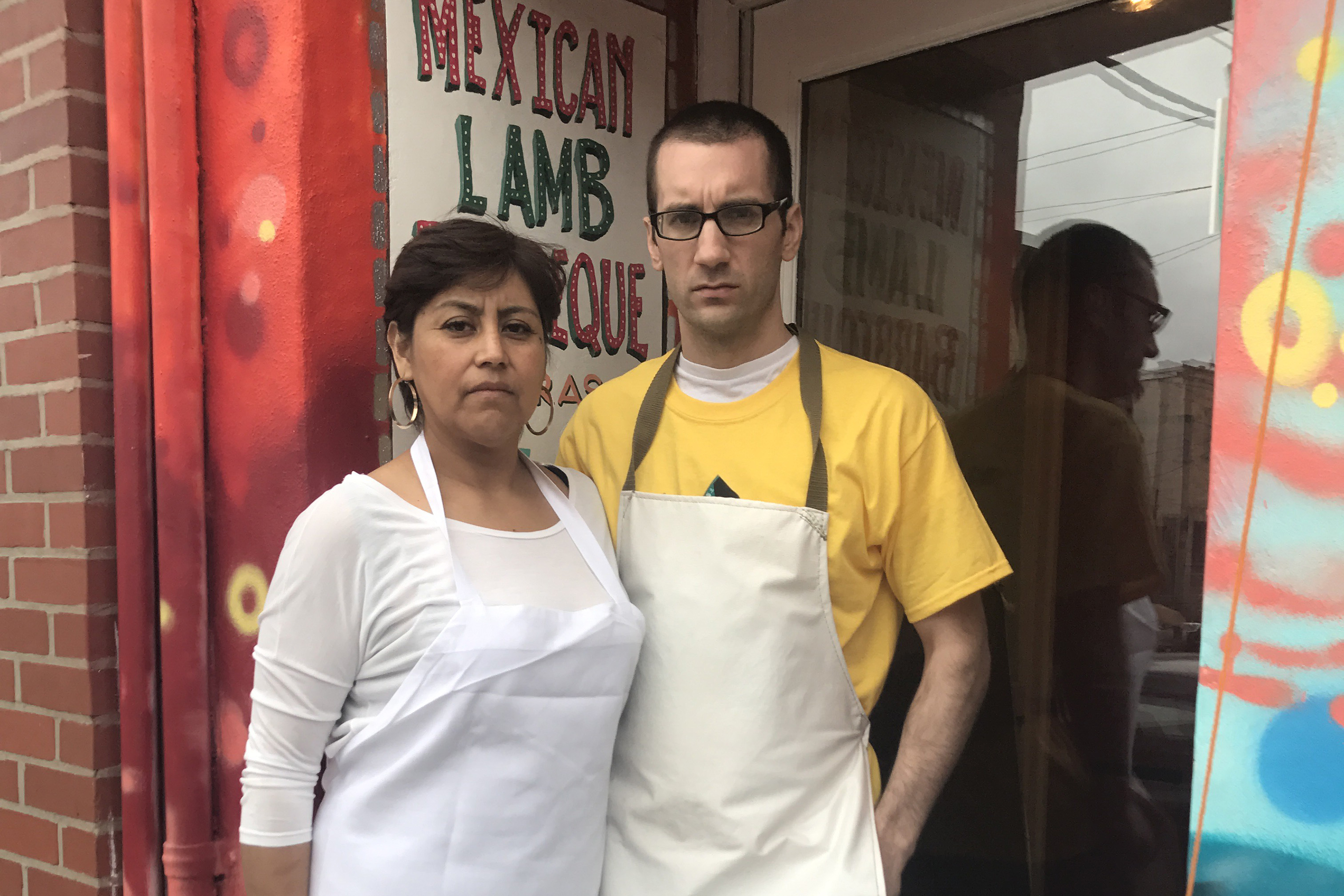 South Philly Barbacoa owners Cristina Martinez and Ben Miller pose outside their restaurant in Philadelphia.