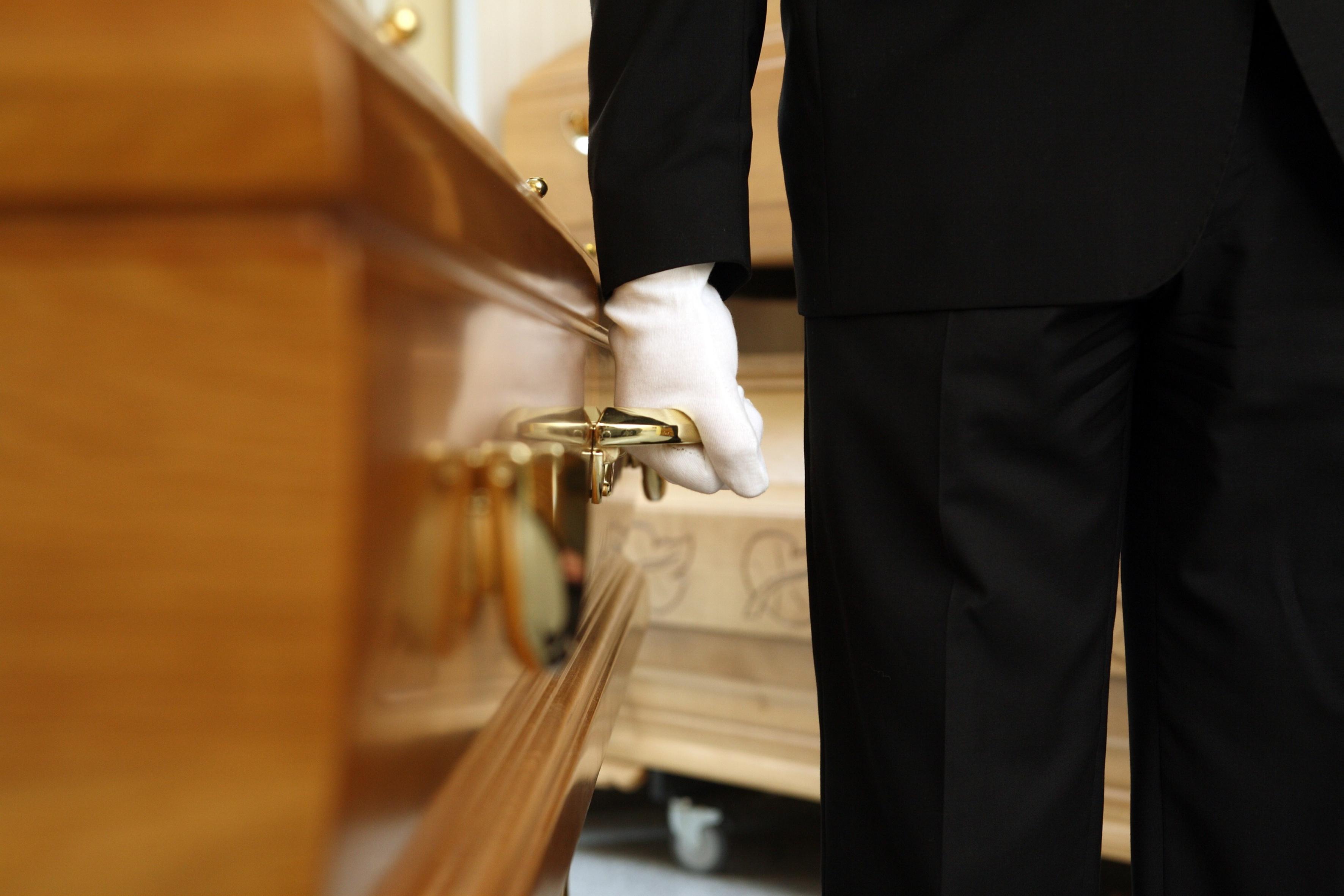 funeral parlour, coffin bearer