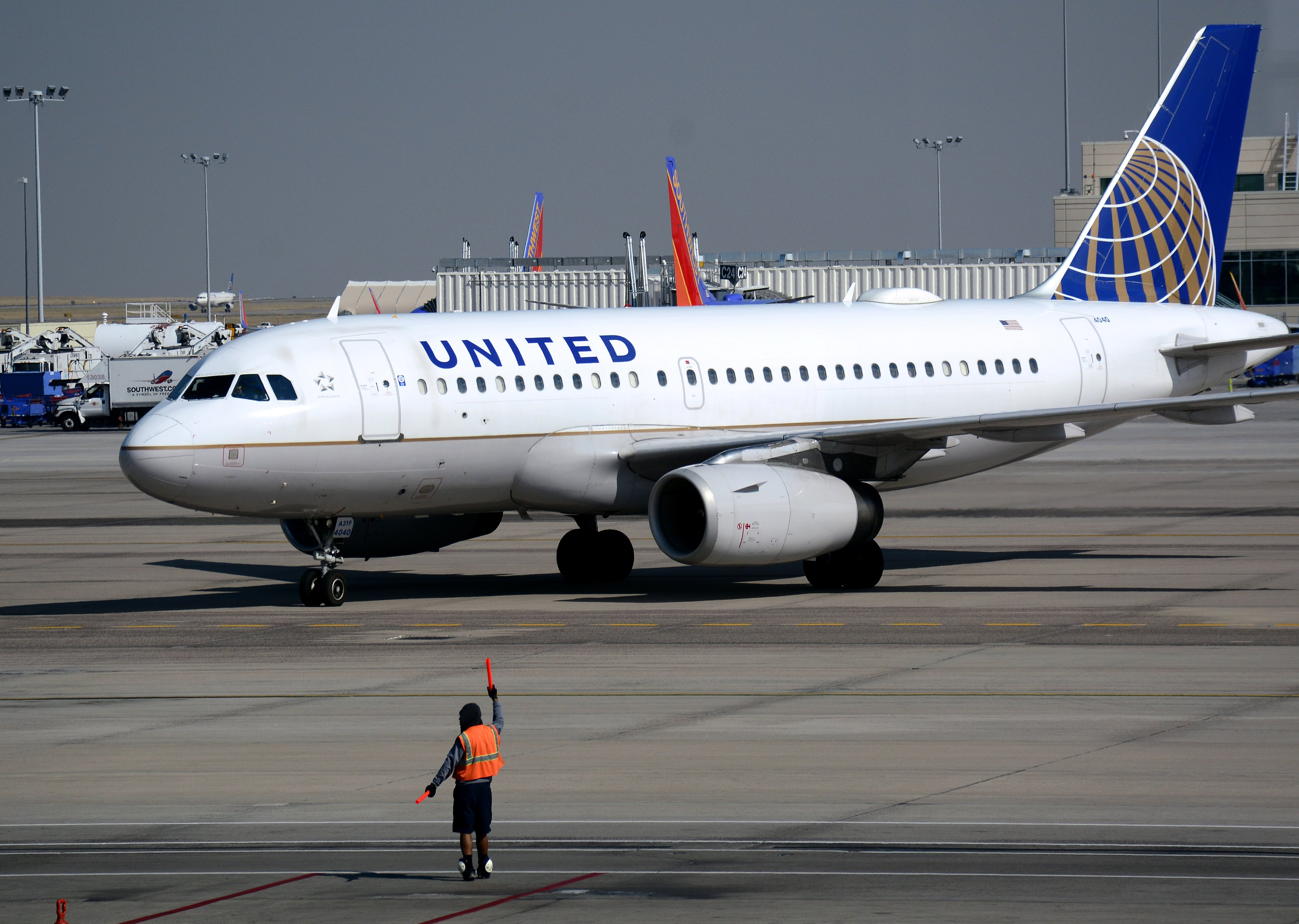 A United Airlines Airbus A319 passenger plane taxis toward a gate at Denver International Airport in Denver, Colorado.