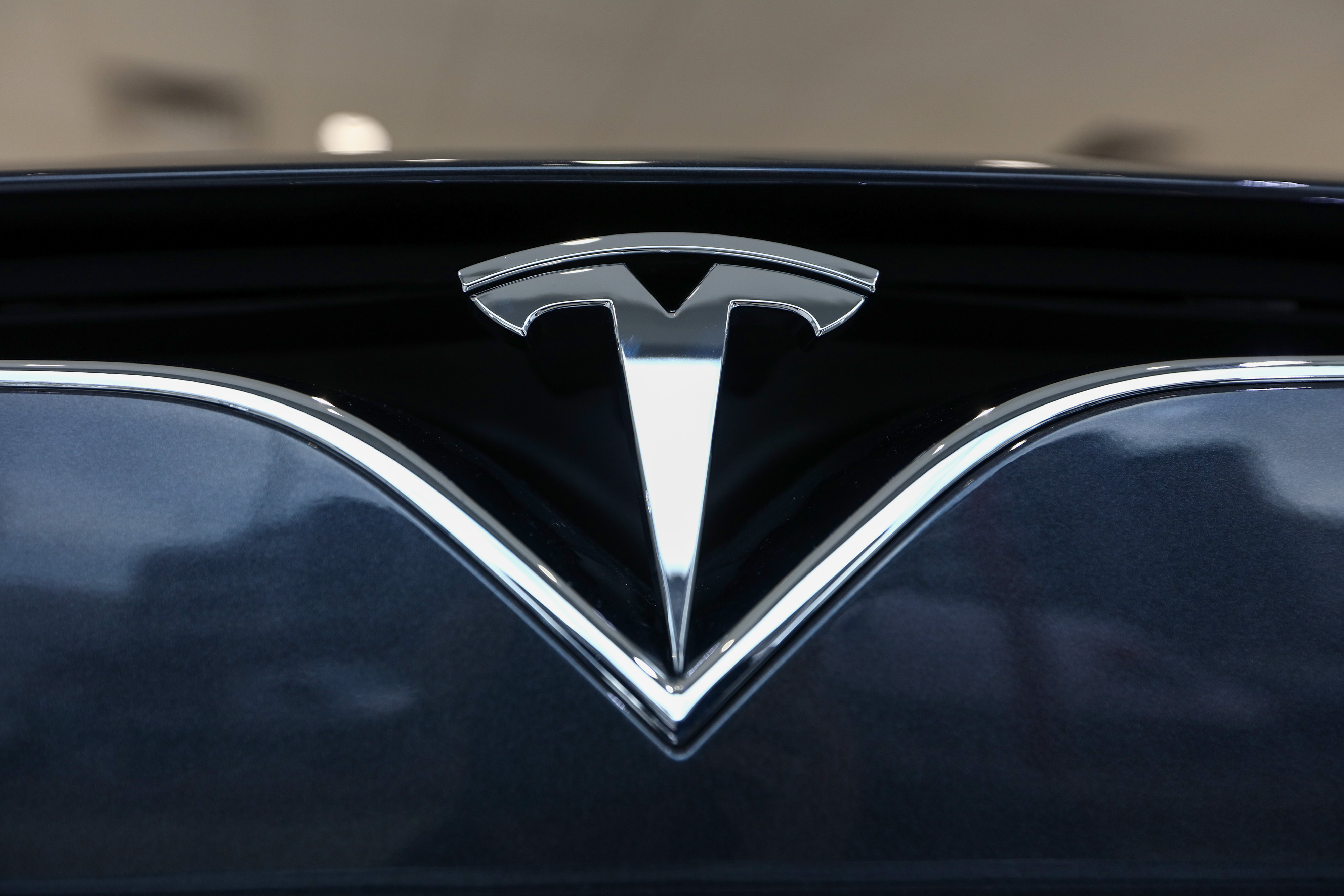The company badge is displayed on the front of a Tesla Model S car at the company's showroom in London on Tuesday, Jan. 10, 2017.