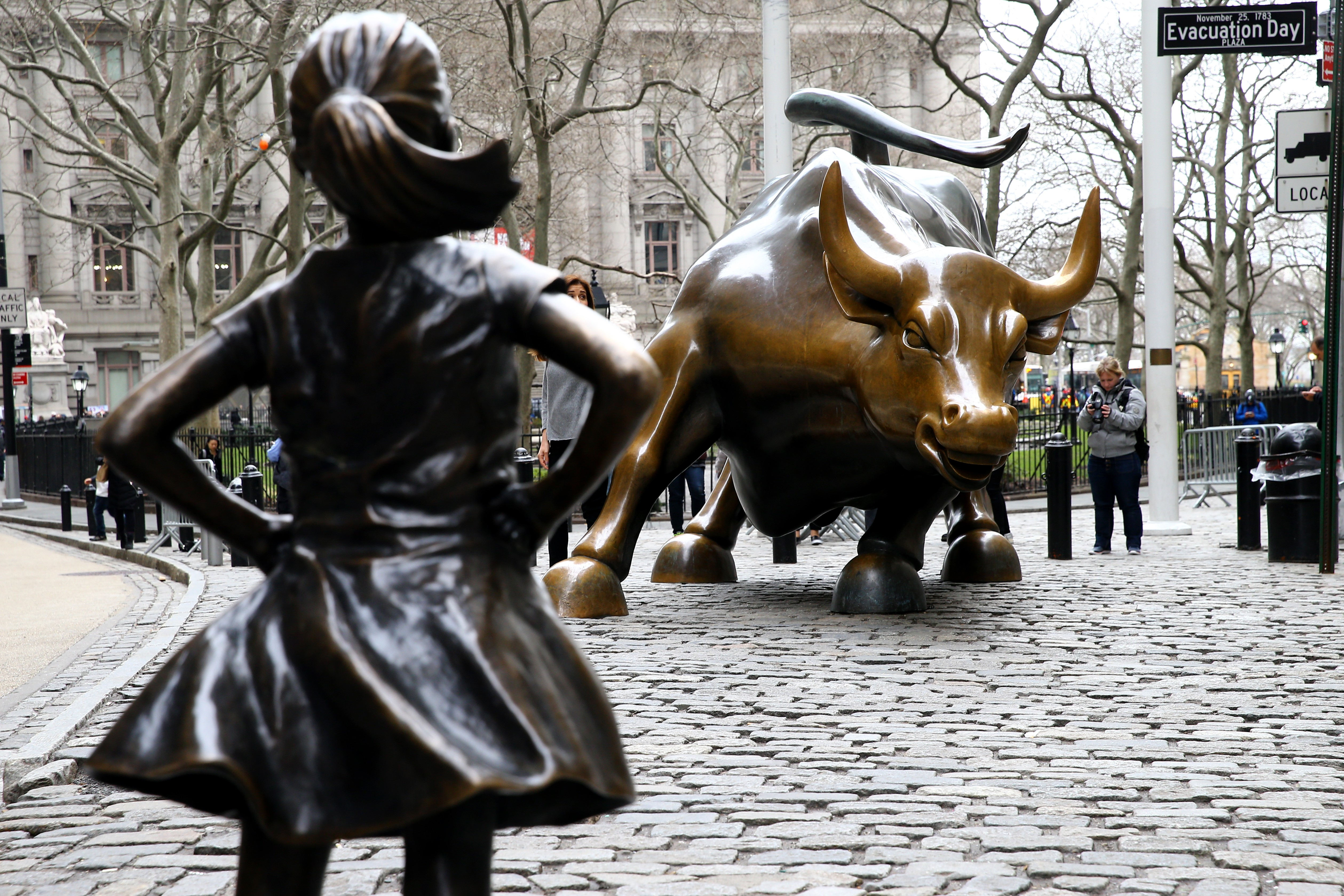 'Fearless Girl' statue face off Wall Street Bull in New York