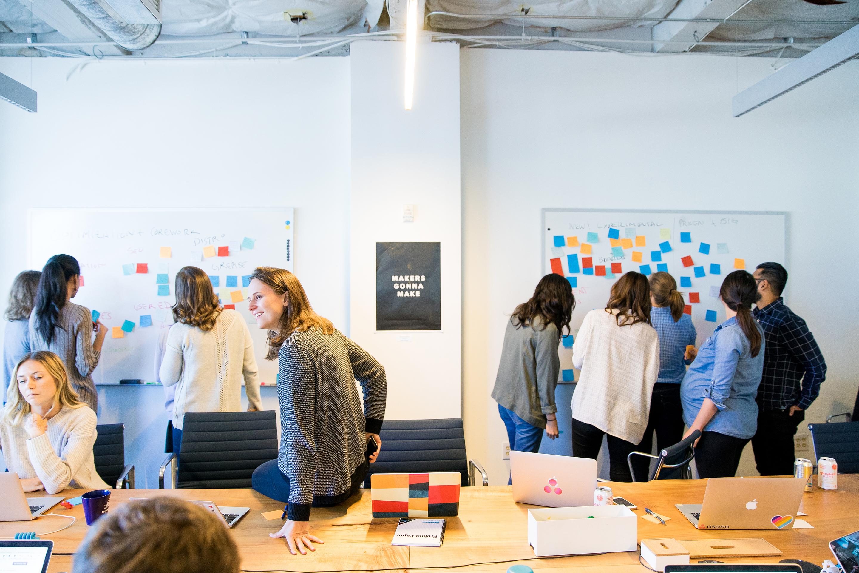 Asana employees brainstorm session.