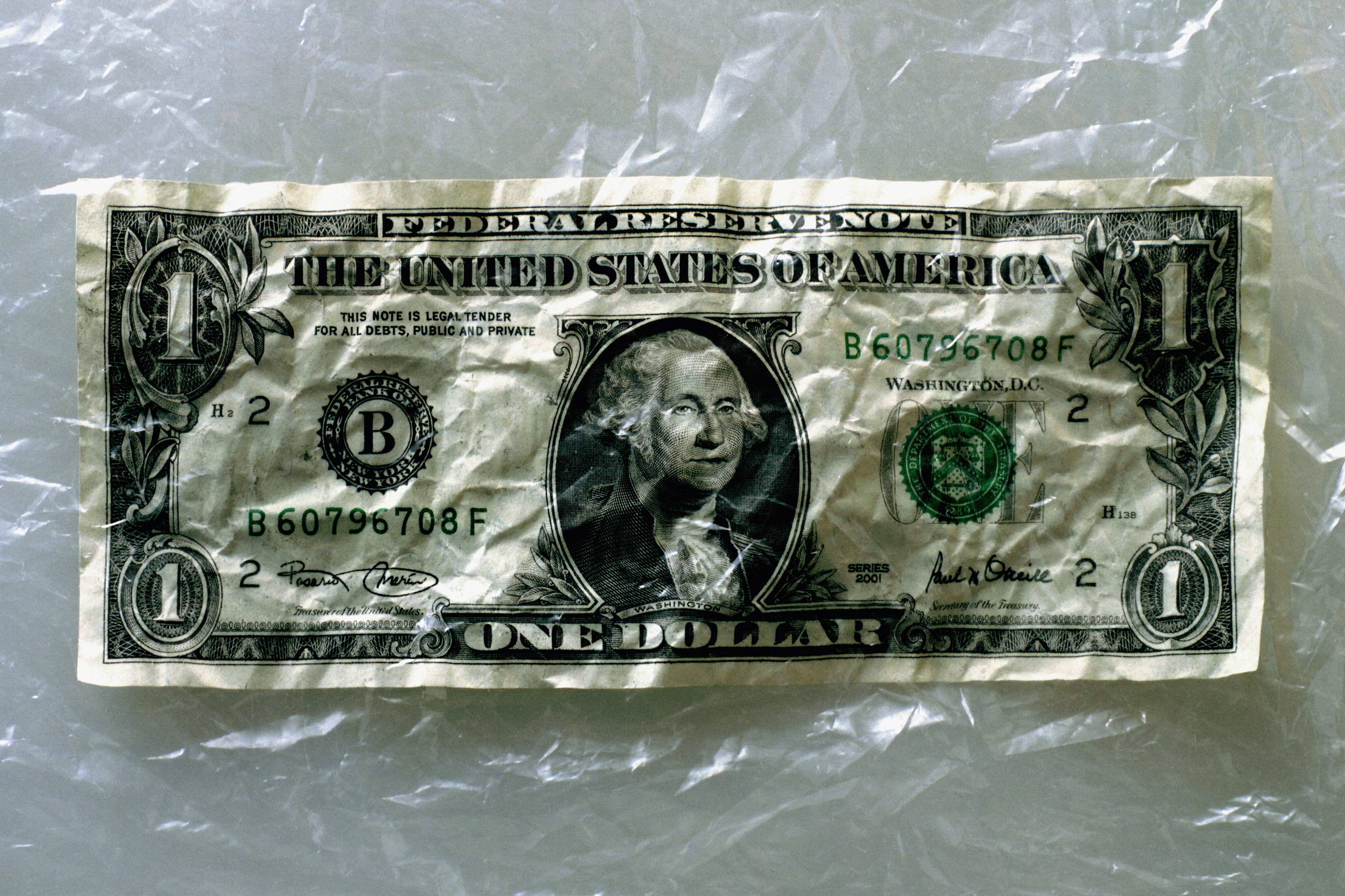 US currency: crumpled one dollar bill
