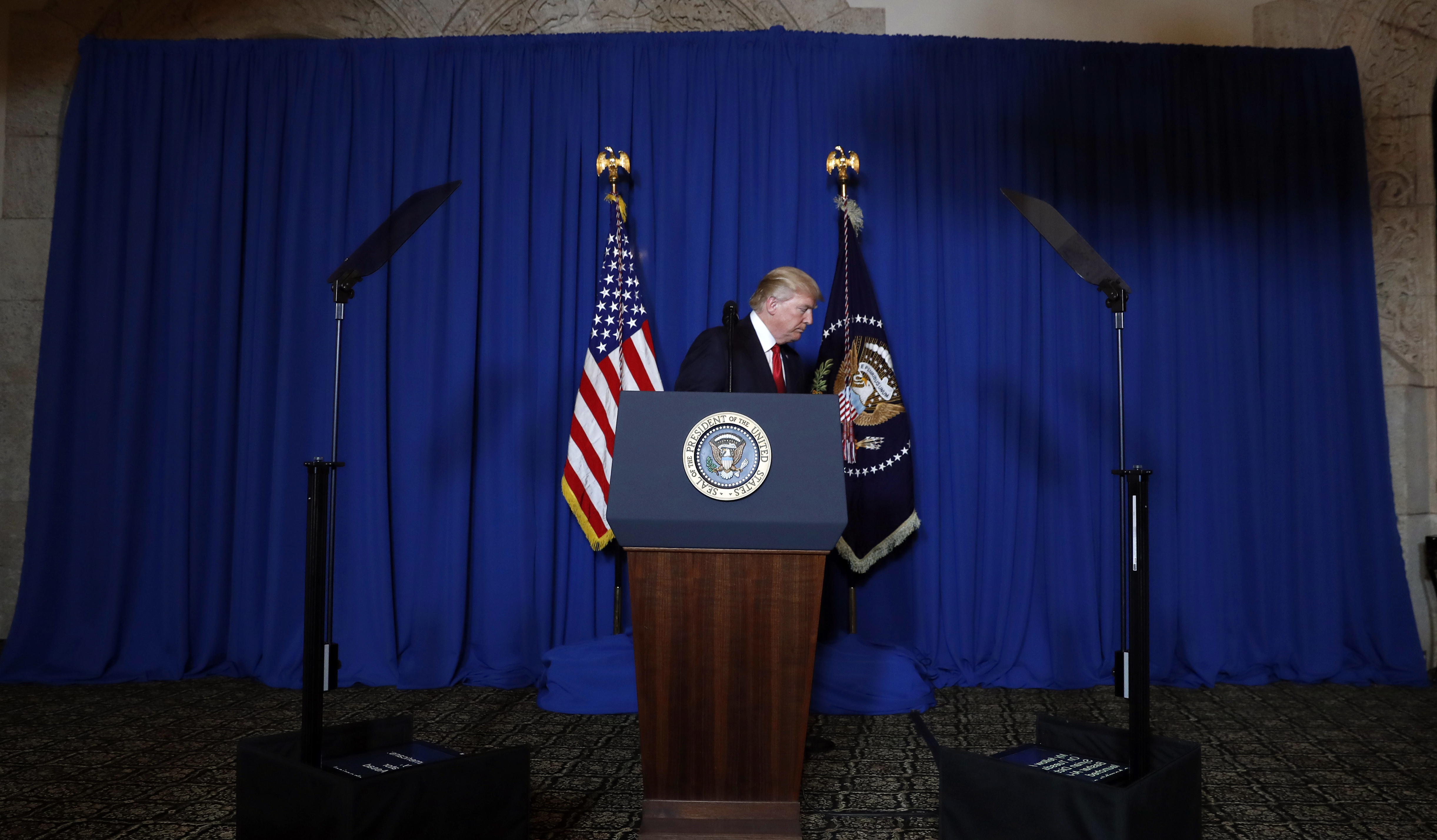 President Donald Trump leaves the podium after speaking at Mar-a-Lago in Palm Beach, Fla., Thursday, April 6, 2017, after the U.S. fired a barrage of cruise missiles into Syria Thursday night in retaliation for this week's gruesome chemical weapons attack against civilians.