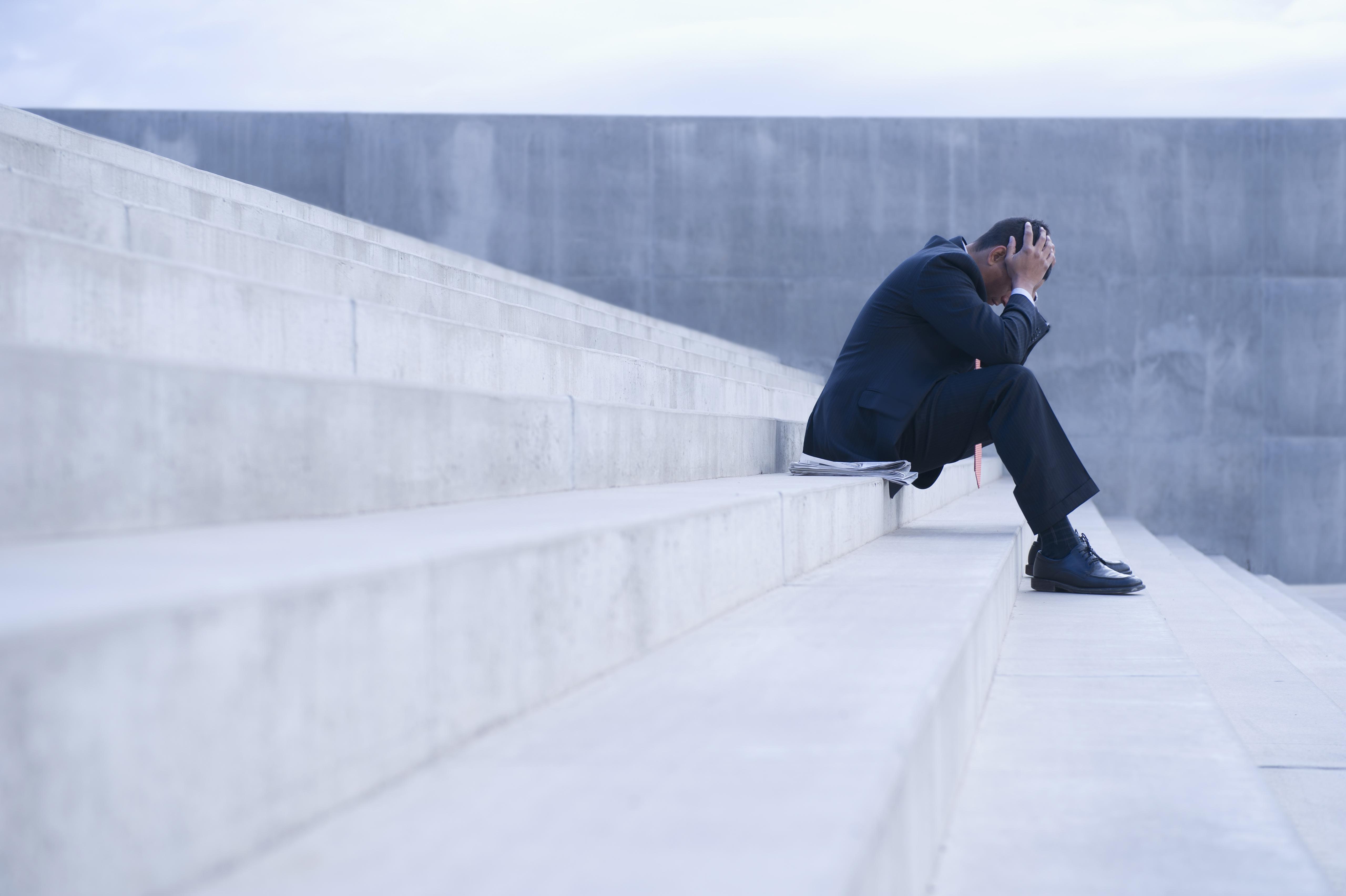 Businessman sitting on steps