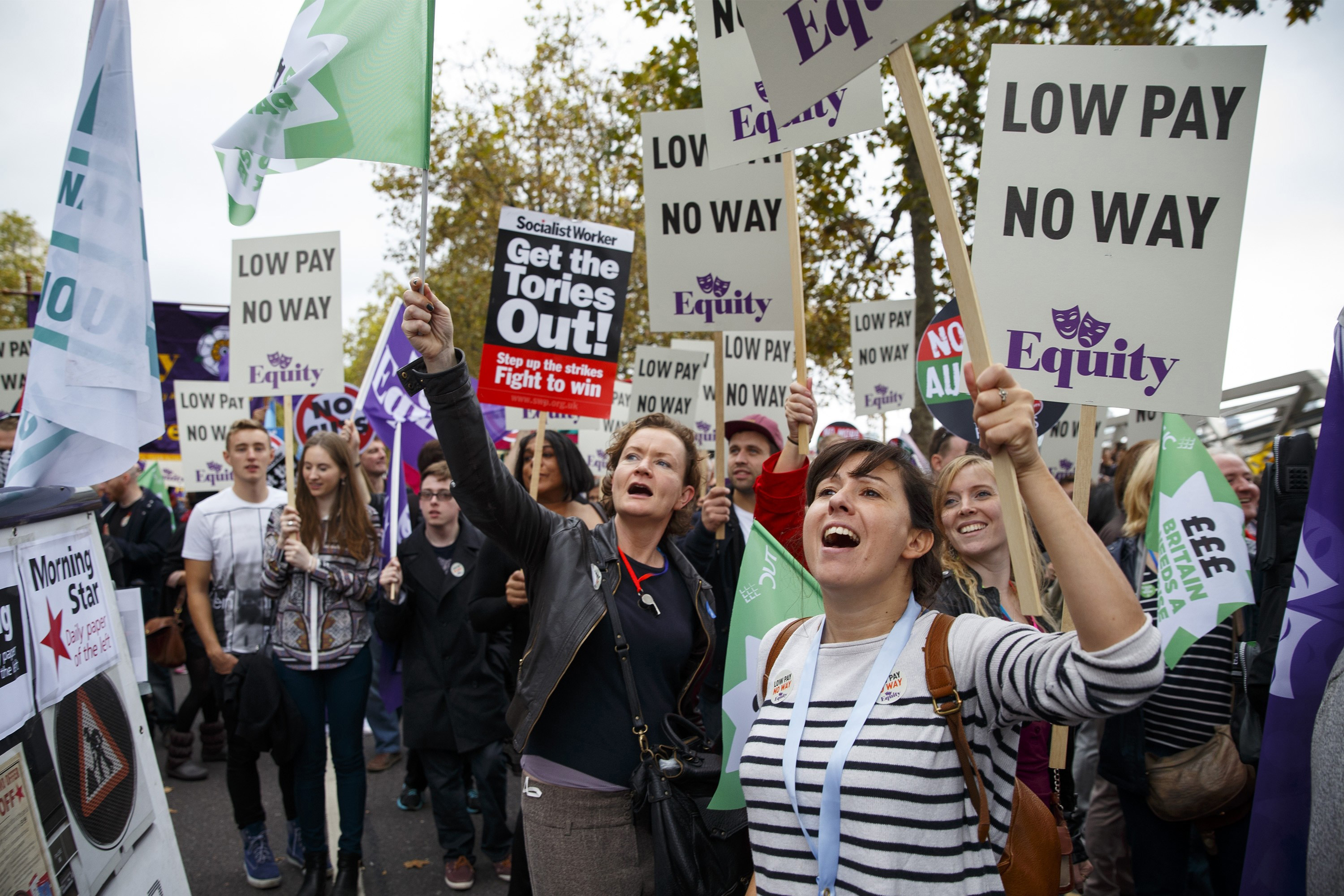 Tens of thousands of workers and public sector workers march during a mass demonstration organized by the Trades Union Congress (TUC) in London to call for an increase in wages.