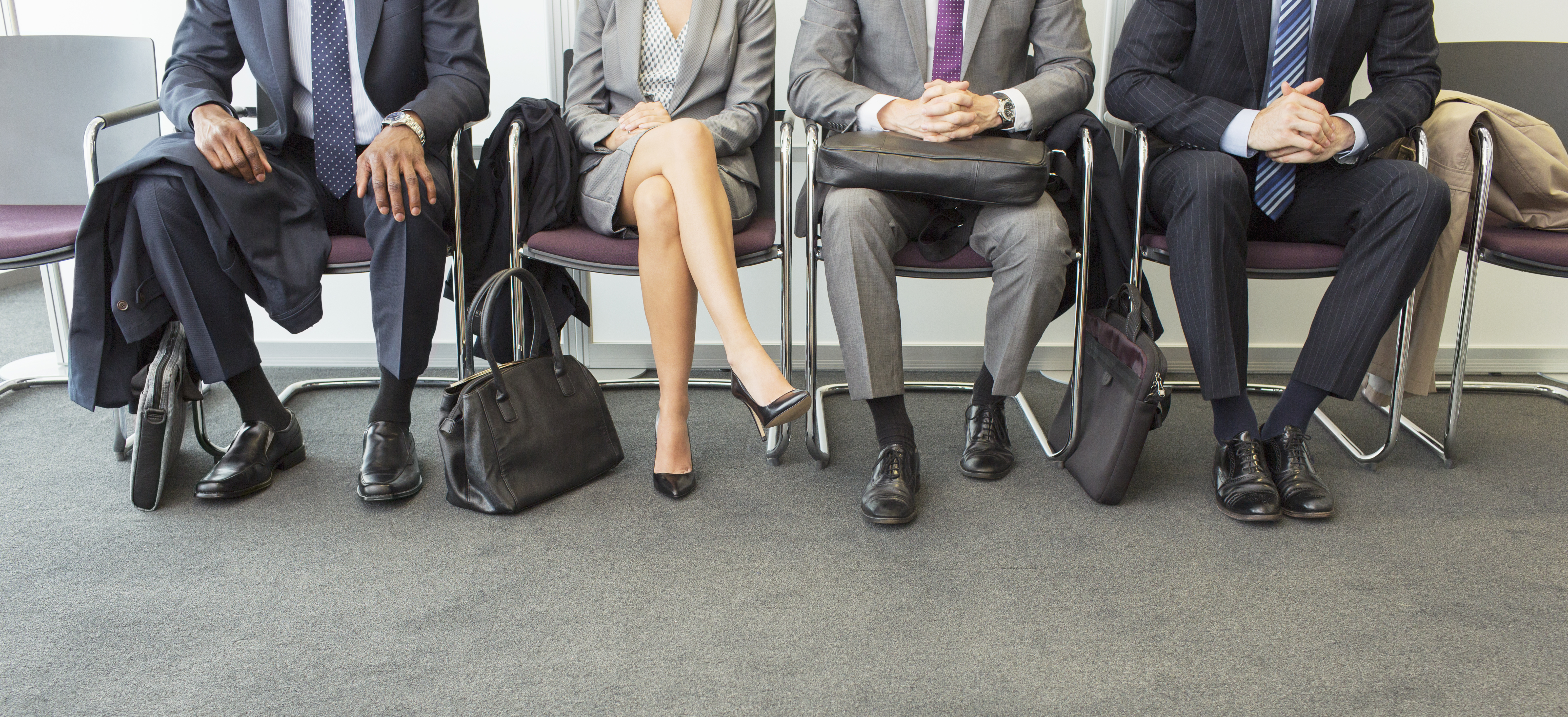 Business people sitting in waiting area
