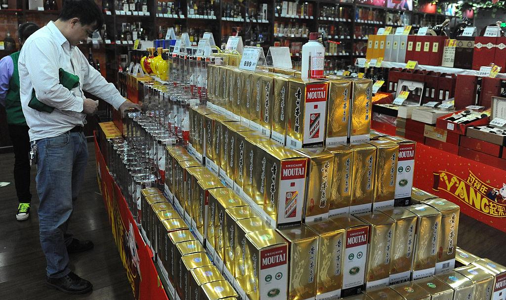 ZHONGSHAN, CHINA - FEBRUARY 09: (CHINA OUT) A customer looks Maotai liquor at a supermarket on February 9, 2015 in Zhongshan, Guangdong Province of China. (Photo by VCG)***_***