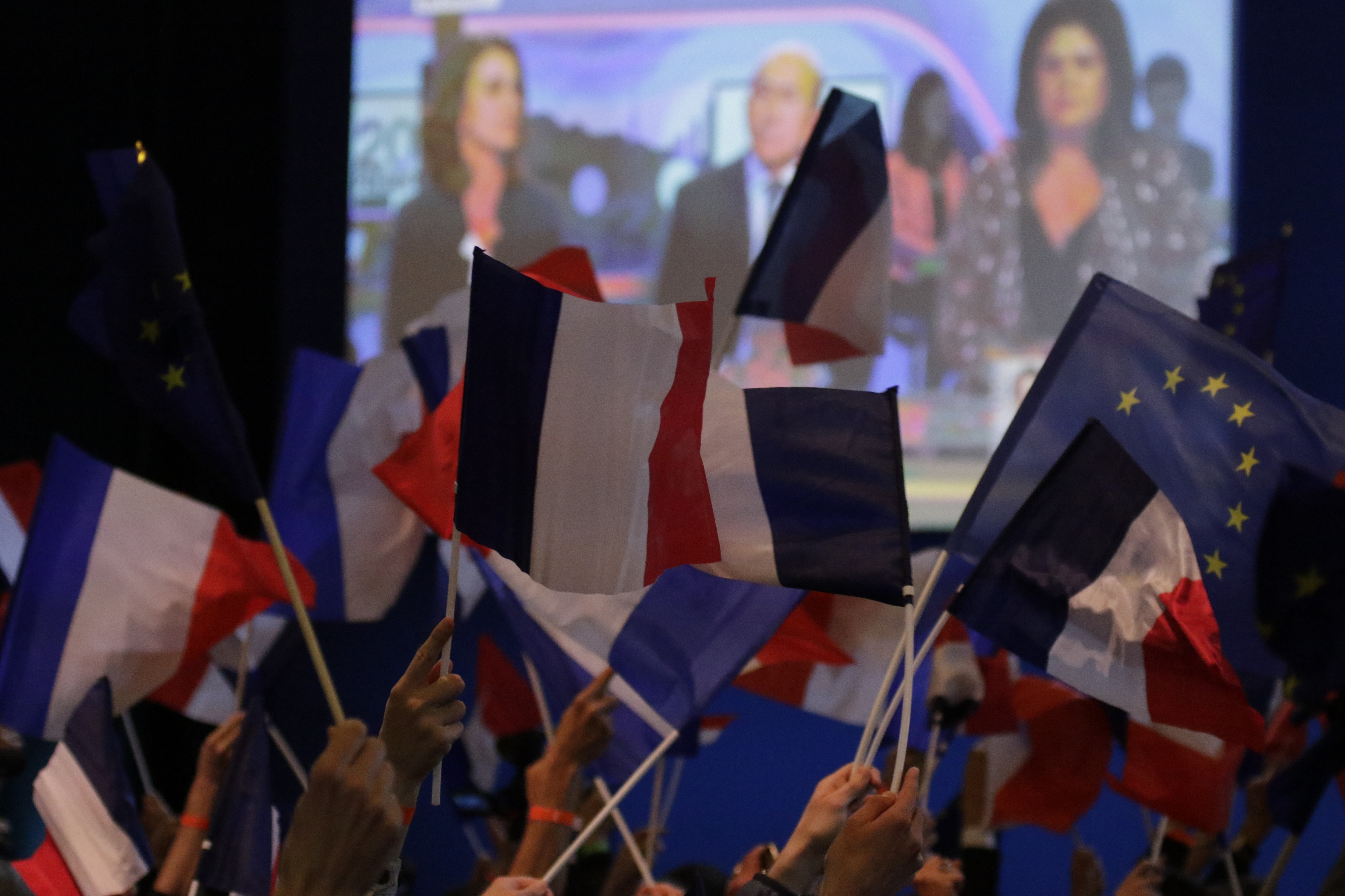 Macron supporters wave French and EU flags after the