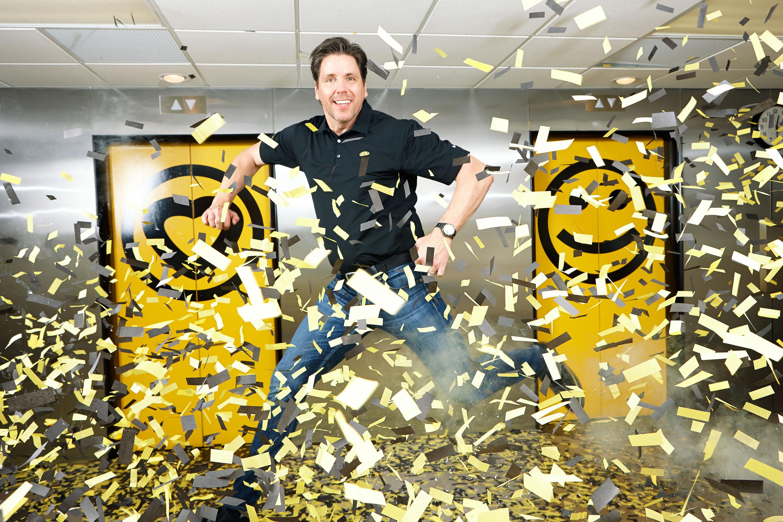 Sinelli enjoys the confetti cannon at Which Wich's Dallas headquarters.