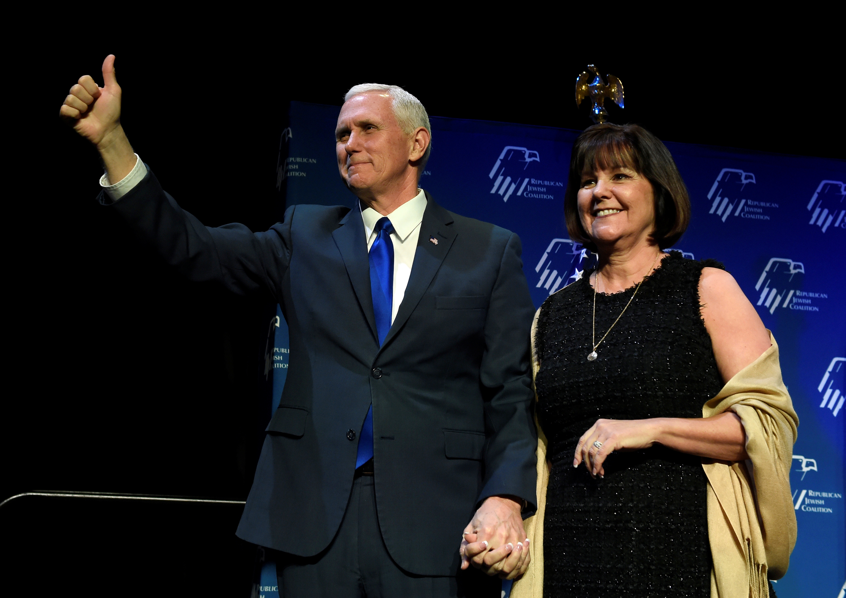 U.S. Vice President Mike Pence, left, and his wife, Karen Pence acknowledge the audience before he speaks at the Republican Jewish Coalition's annual meeting in Las Vegas