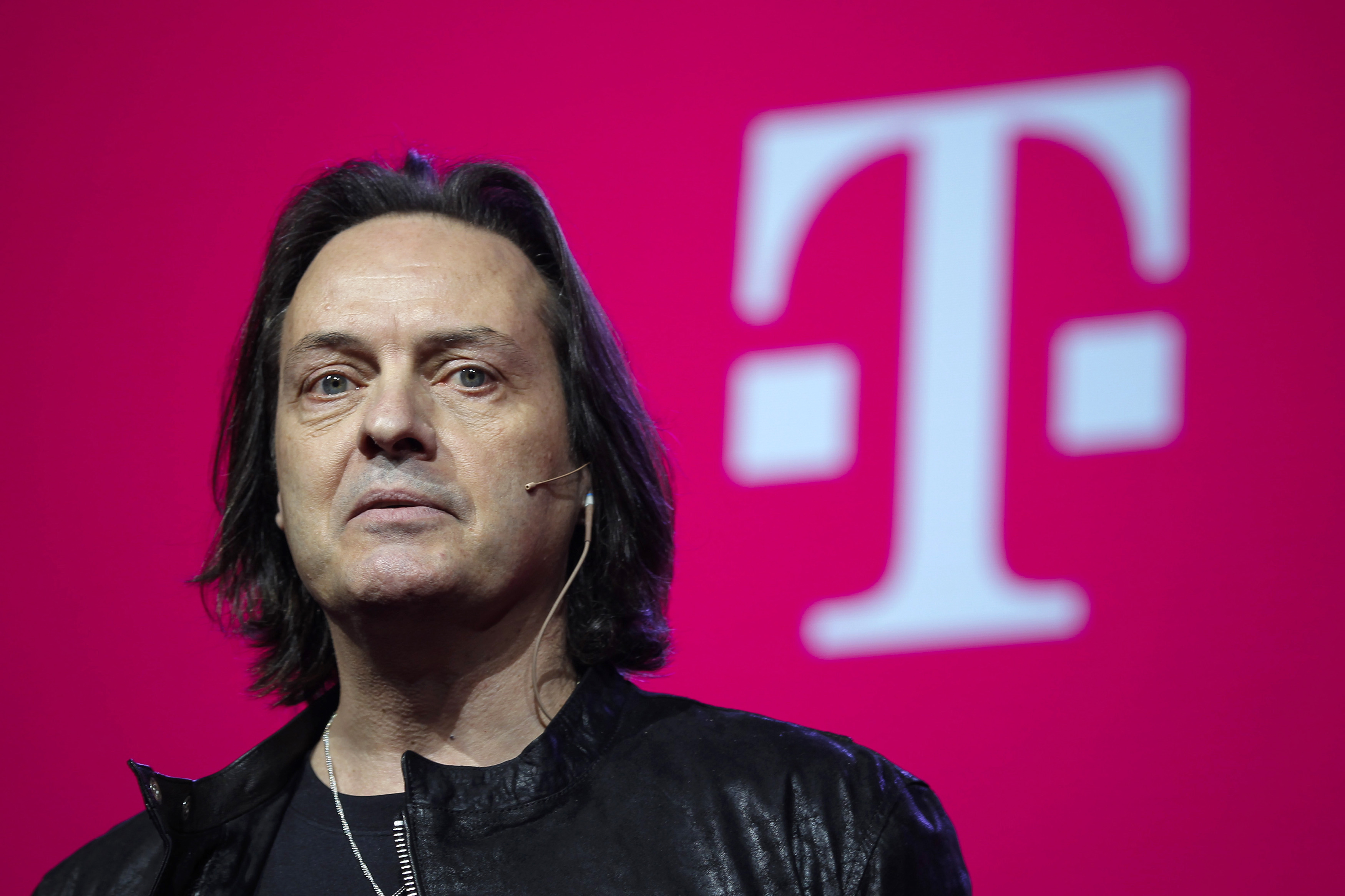 T-Mobile CEO Legere speaks to guests during their company's Un-carrier 9.0 event in New York