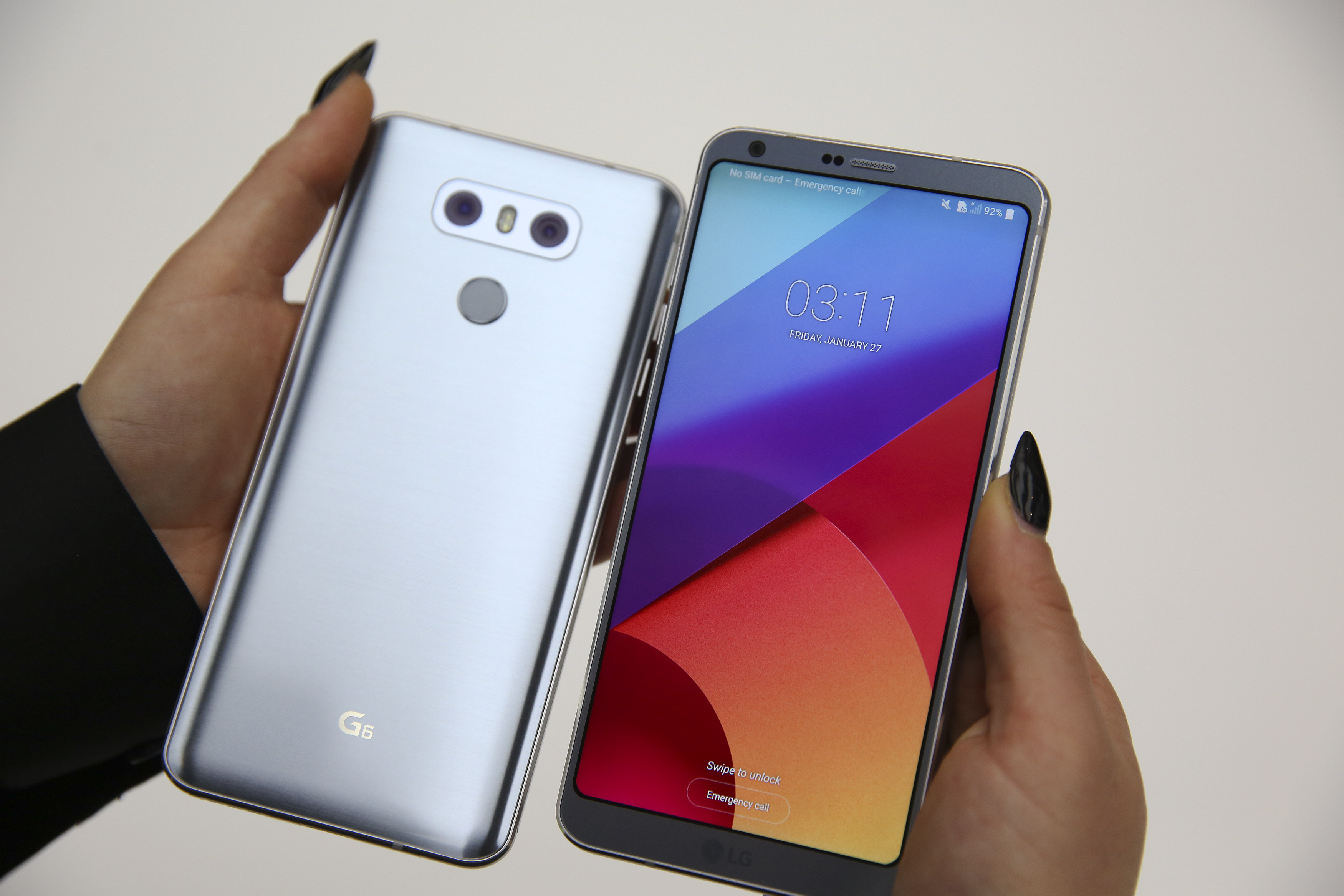 The LG G6 device is displayed at the LG stand at the Mobile World Congress in Barcelona