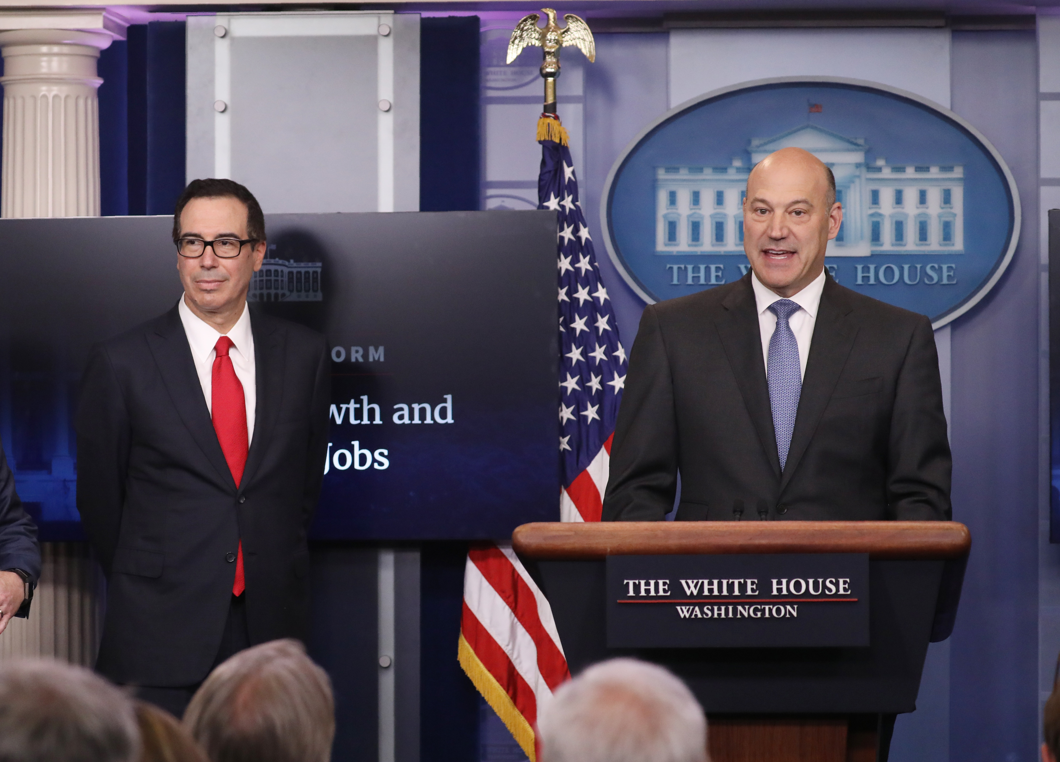 U.S. National Economic Director Gary Cohn (R) and Treasury Secretary Steven Mnuchin unveil the Trump administration's tax reform proposal at the White House on Wednesday.