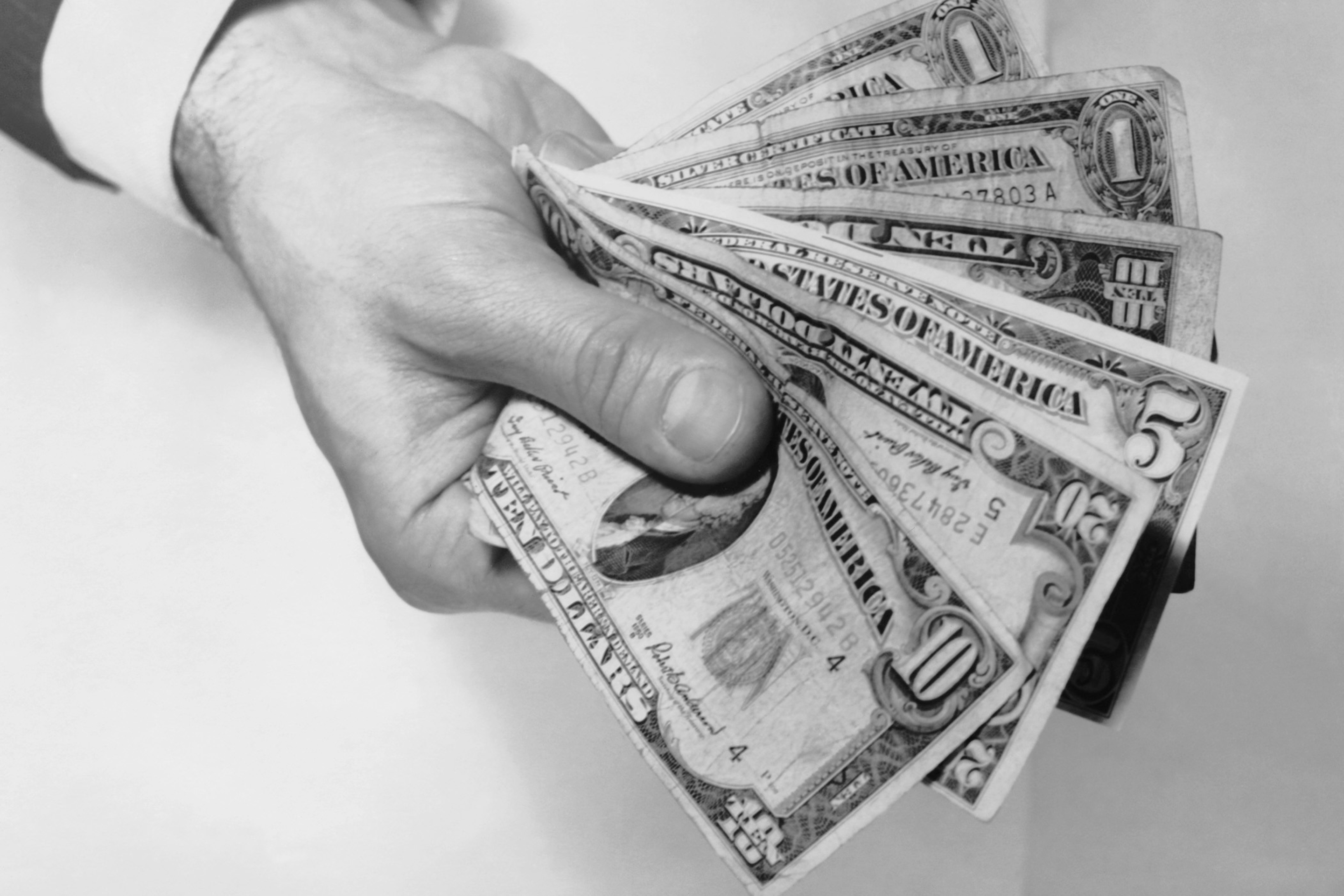 Hand holding out money